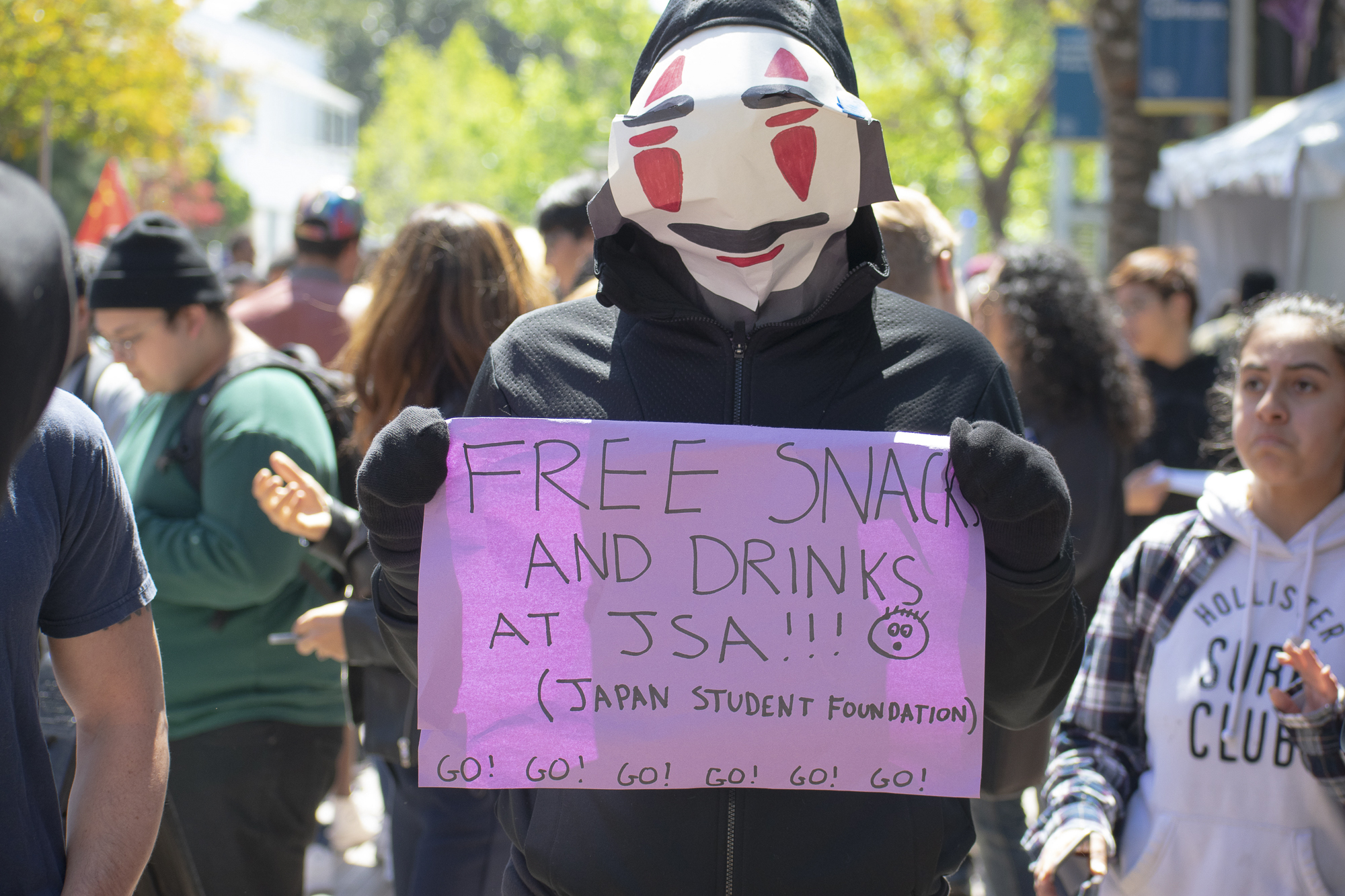 A student from the Japanese Student Association advertises their booth as they walk through the quad of Santa Monica College during Club Row on Thursday, April 26, 2018 in Santa Monica, California. With over 60 clubs in attendance, the day is meant to encourage clubs to showcase what they've been doing over the semester for students. (Ethan Lauren/Corsair Photo)