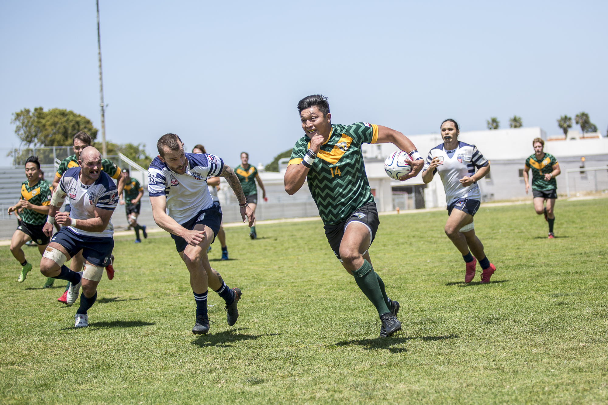 Santa Monica Dolphin rugby forward Joey Krassenstein (#14, green)  charges down the field during the 1st half of the game, which was held at Westchester High School in Westchester California on Saturday April 28 2018. The Santa Monica Dolphins would go on to lose the game 7-26 during Saturday's game. (Matthew Martin/Corsair Photo)