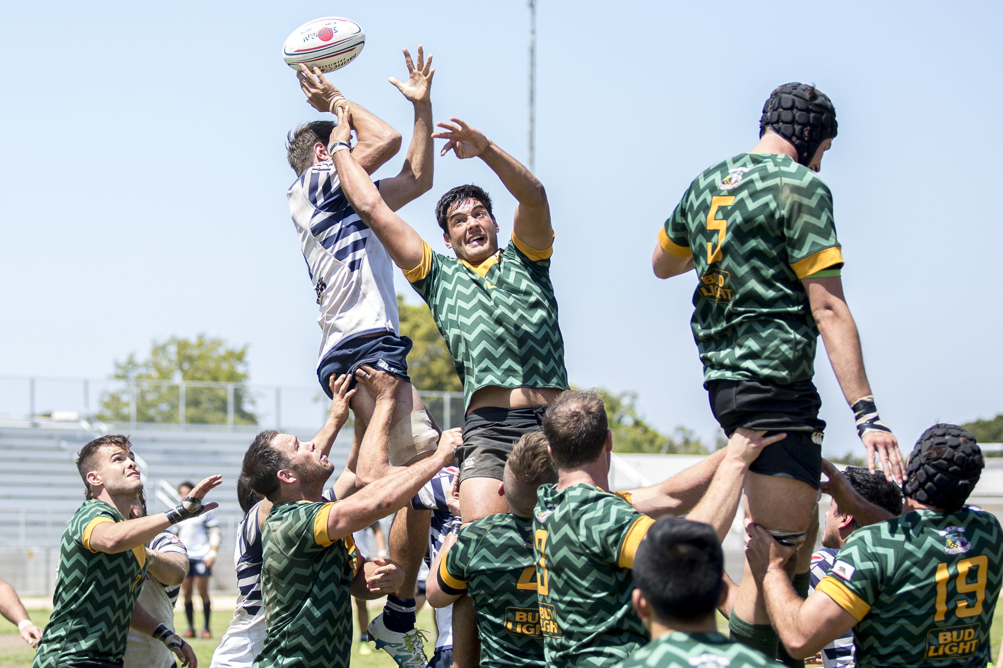Santa Monica Dolphin Rugby forward Chris Allman #6 (center, green) fails to intercept the lineout throw while competing against Old Mission Beach Athletic Club (OMBAC), which was held at Westchester High School in Westchester California on Saturday April 28 2018. The Santa Monica Dolphins would go on to lose the game 7-26 during Saturdays game. (Matthew Martin/Corsair Photo)