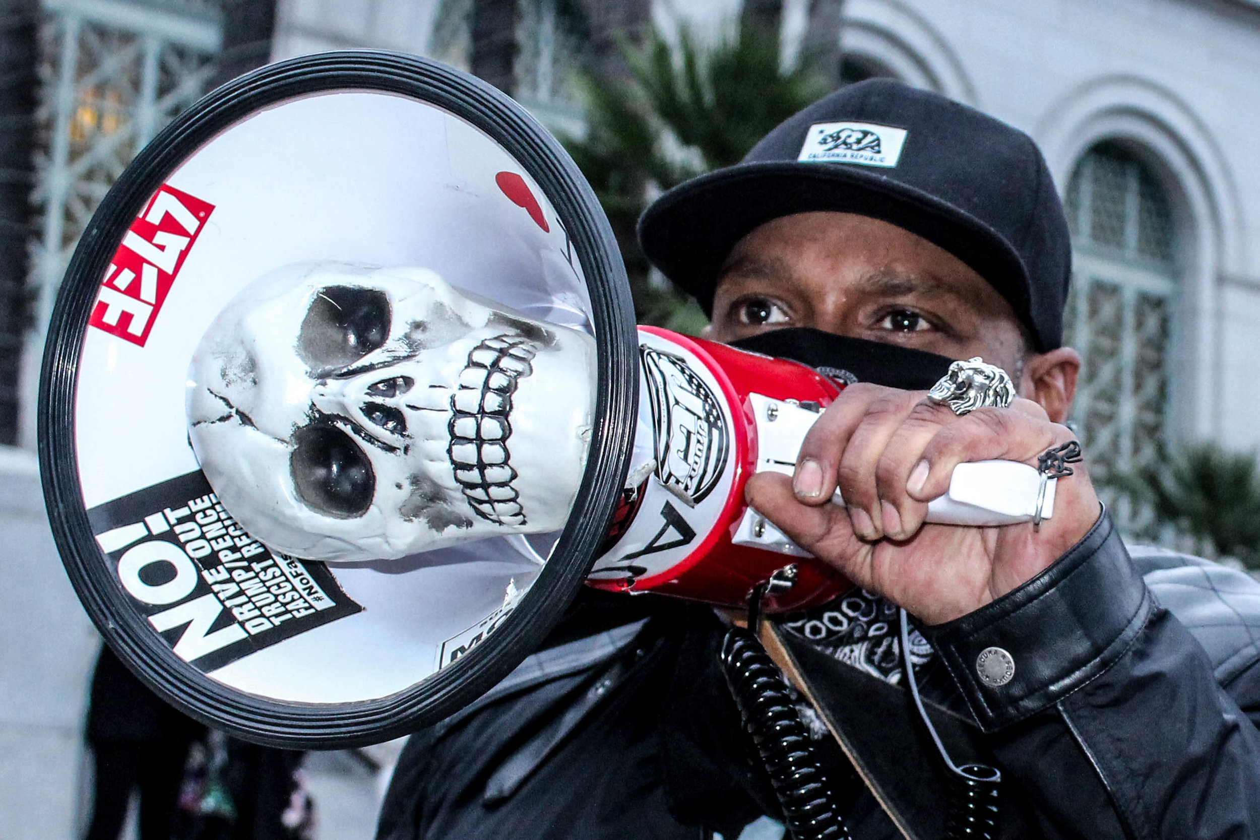 A protestor who wished to stay anonymous shows support for workers' rights by leading like-minded individuals at the May Day Protest in downtown Los Angeles on May 1, 2018 (Daniel Farr/Corsair Photo).