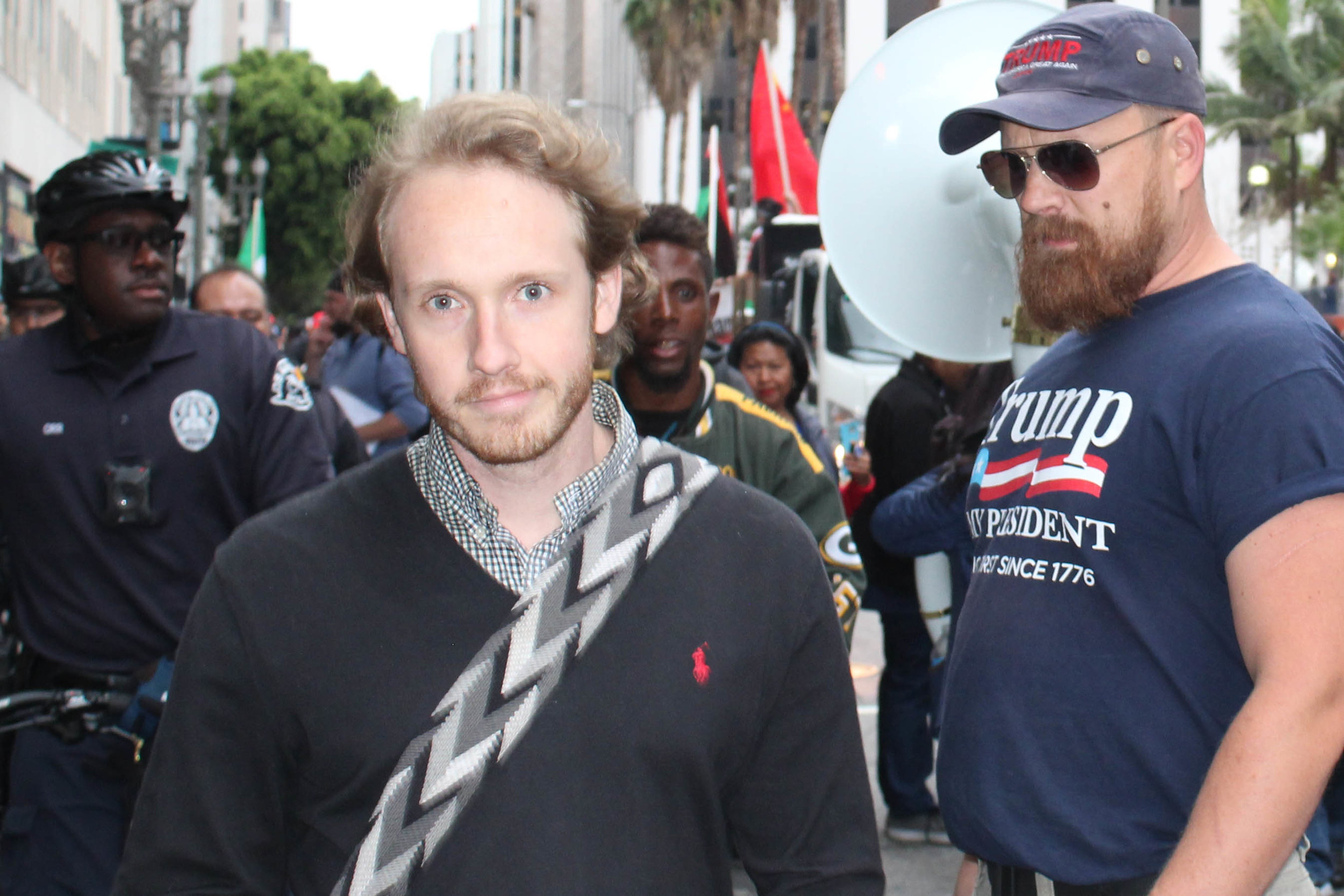 A Donald Trump supporter gets ready to confront an anti-Trump supporter after he spit near his feet at the May Day Protest in downtown Los Angeles on May 1, 2018. (Daniel Farr/ Corsair Photo).