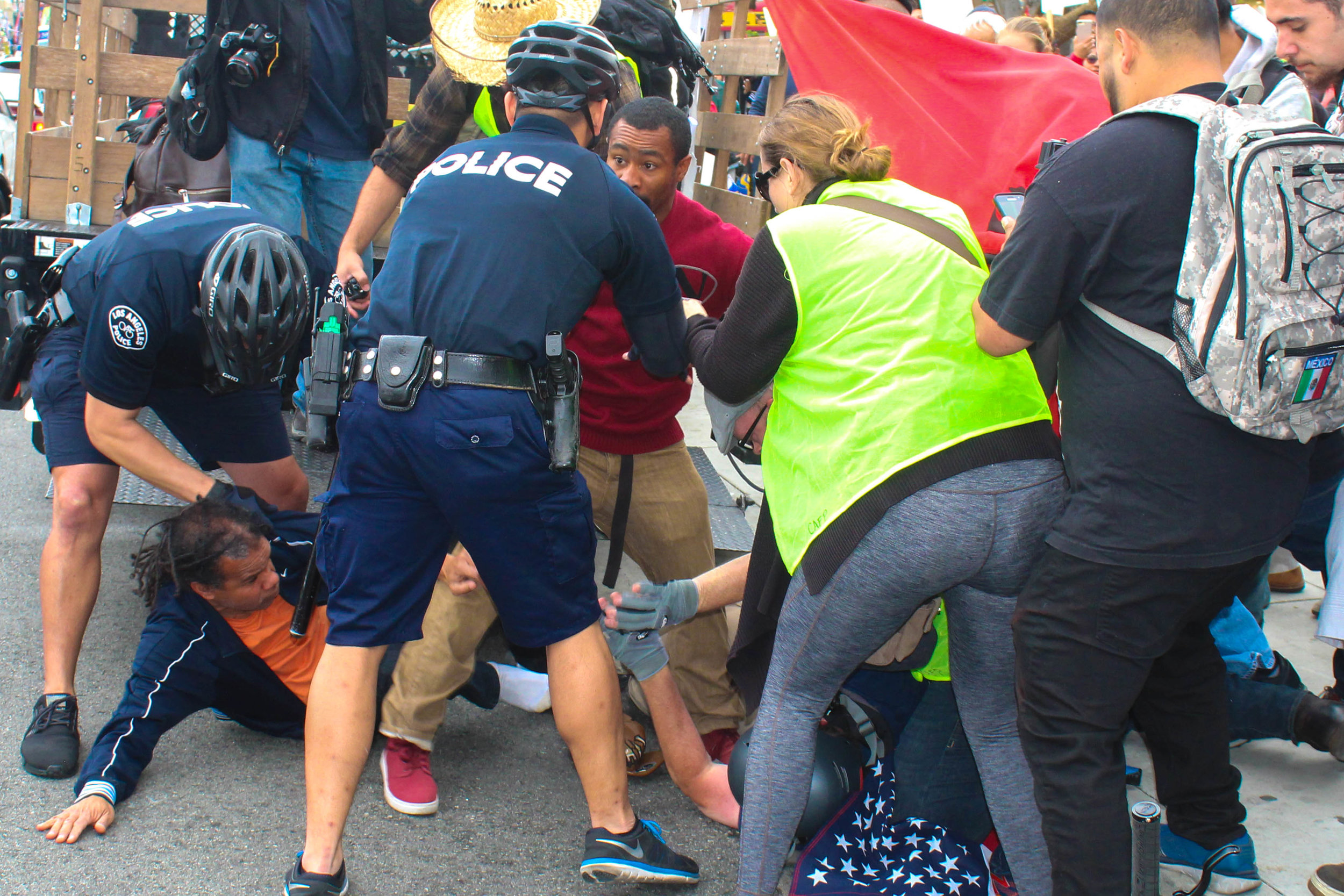 Police tackle Washington Azeveel at the May Day Protest in Downtown Los Angeles on May 1, 2018 because two event attendees began pushing one another. (Daniel Farr/Corsair Photo)