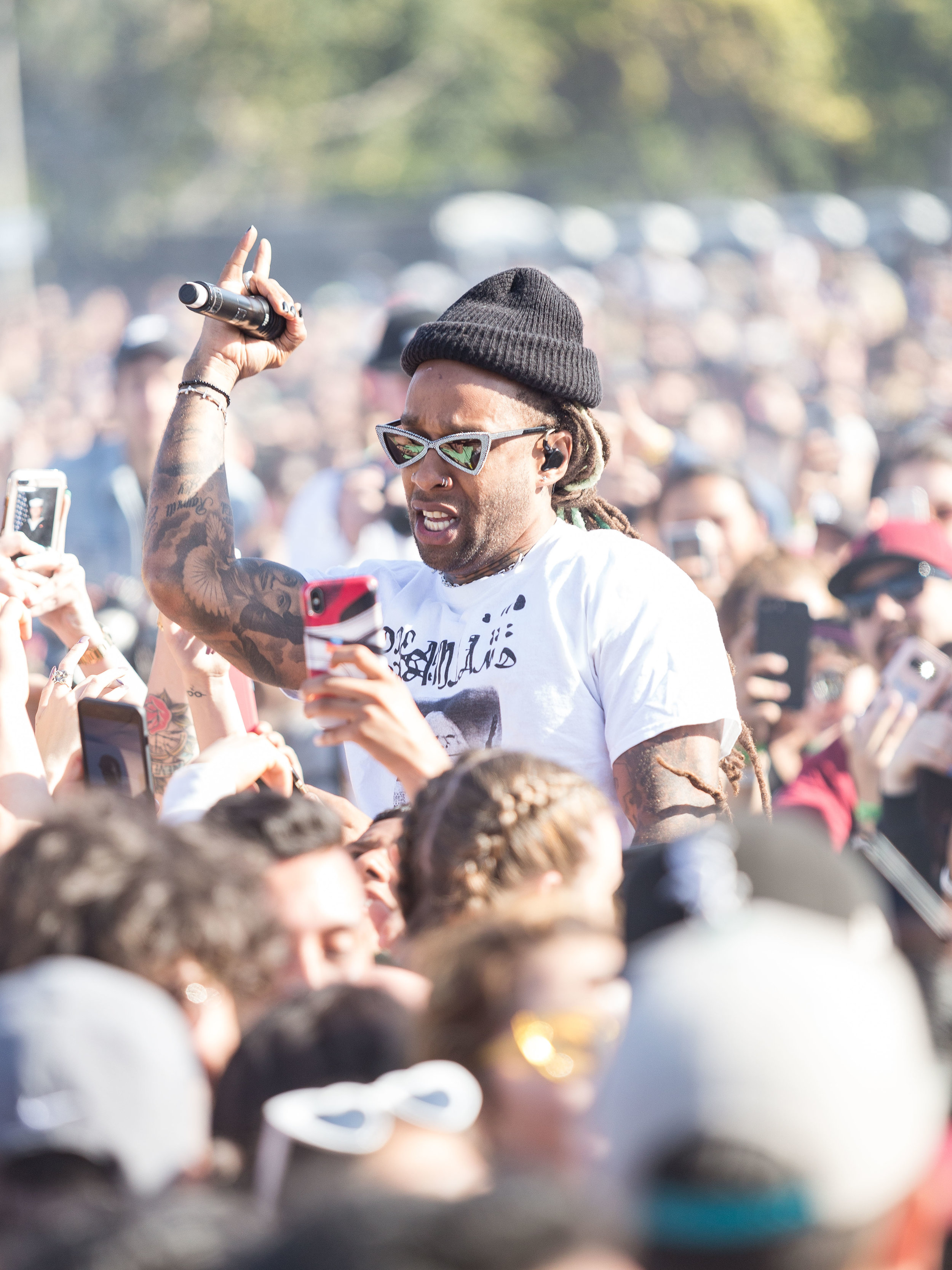 Artists Ty Dolla $ign (Tyrone William Griffin) begins his performance by entering the photo pit and rapping along with the crowd at the the Stick.E.Vape during The Smokers Club Festival at the Queen Mary in Long Beach, California on Sunday, April 29th 2018. (Thane Fernandes/ Corsair Photo)