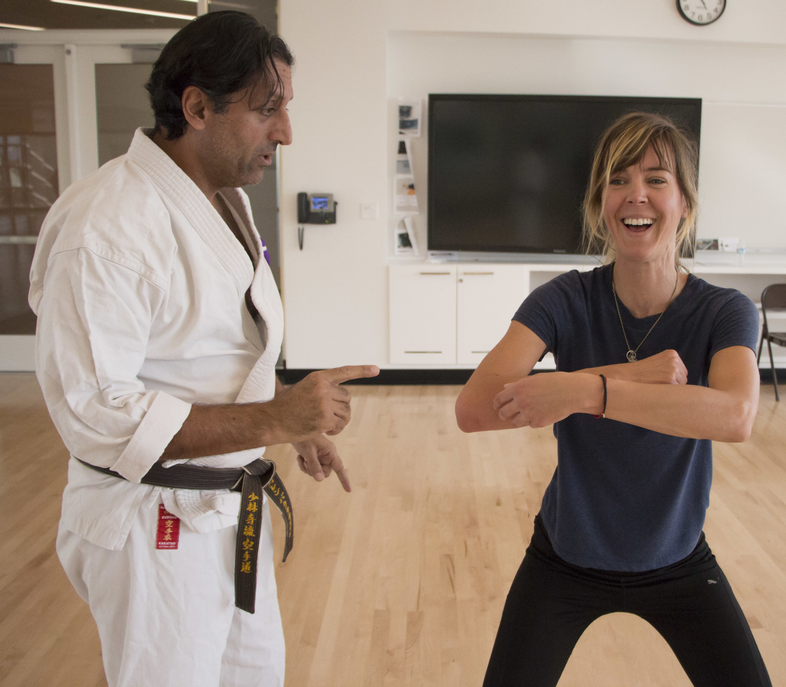 Ida Barklund laughs as Professor Baghdasarian gives her advice on her technique in the karate class at the CPC of Santa Monica College in Santa Monica, California on Thursday, April 18, 2018. (Wilson Gomez/Corsair Photo)