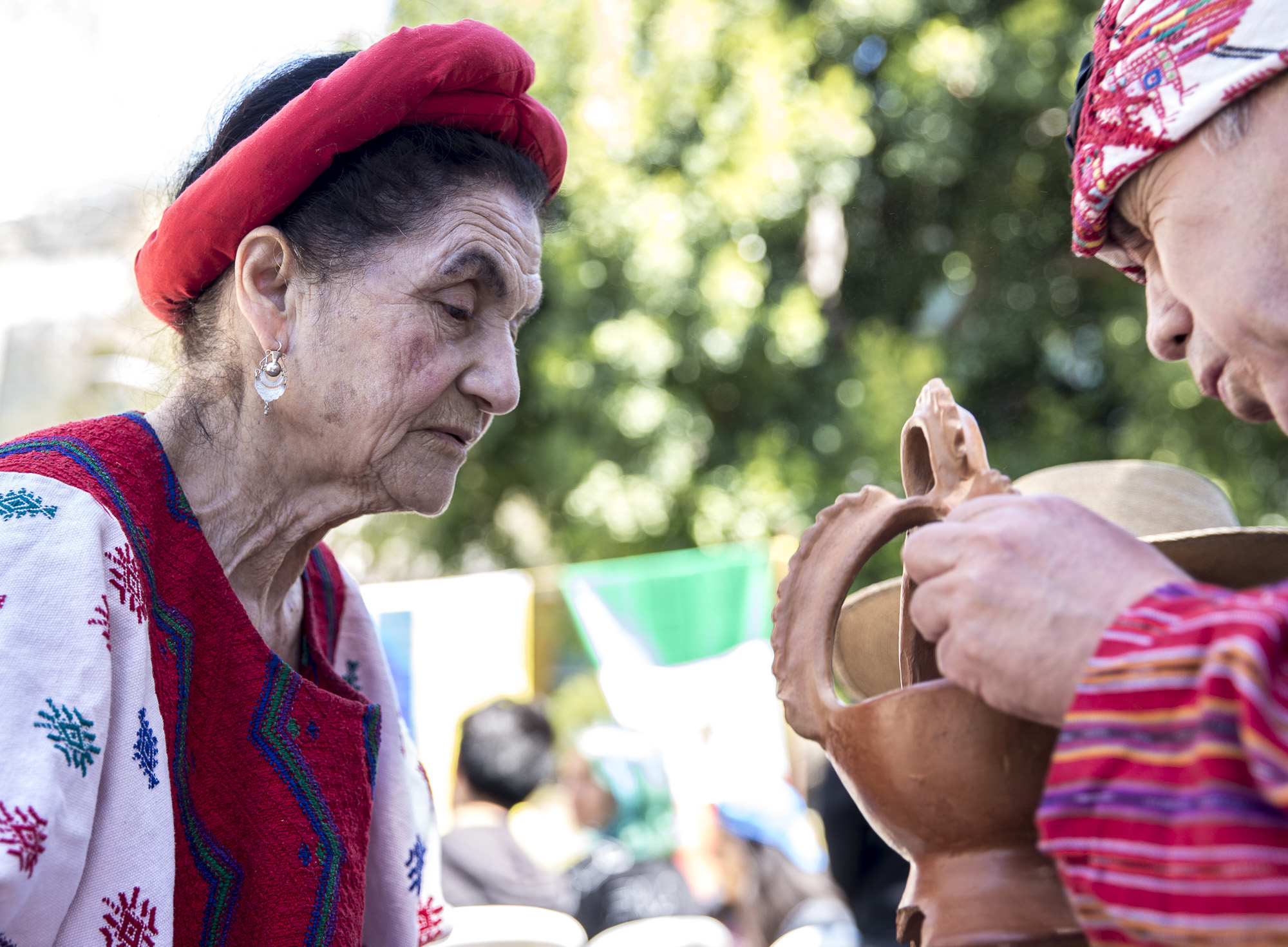 """Evita Dubón (left) and Jorge Granja (right) prepare sage for the traditional Guatemalan dance they will be performing at the Santa Monica College (SMC) Cinco De Mayo celebration event in front of the clock tower on the SMC main campus on Thursday, May 3 2018.  This event was put together by the Santa Monica College club """"Adelante,"""" whose goal at the event was to inform students about the origins of Cinco De Mayo and put to rest the stereotypes that come with the holiday, specifically the misperception that it is a day of independence for Mexico and also that is just a drinking holiday in the United States. (Matthew Martin/Corsair Photo)"""