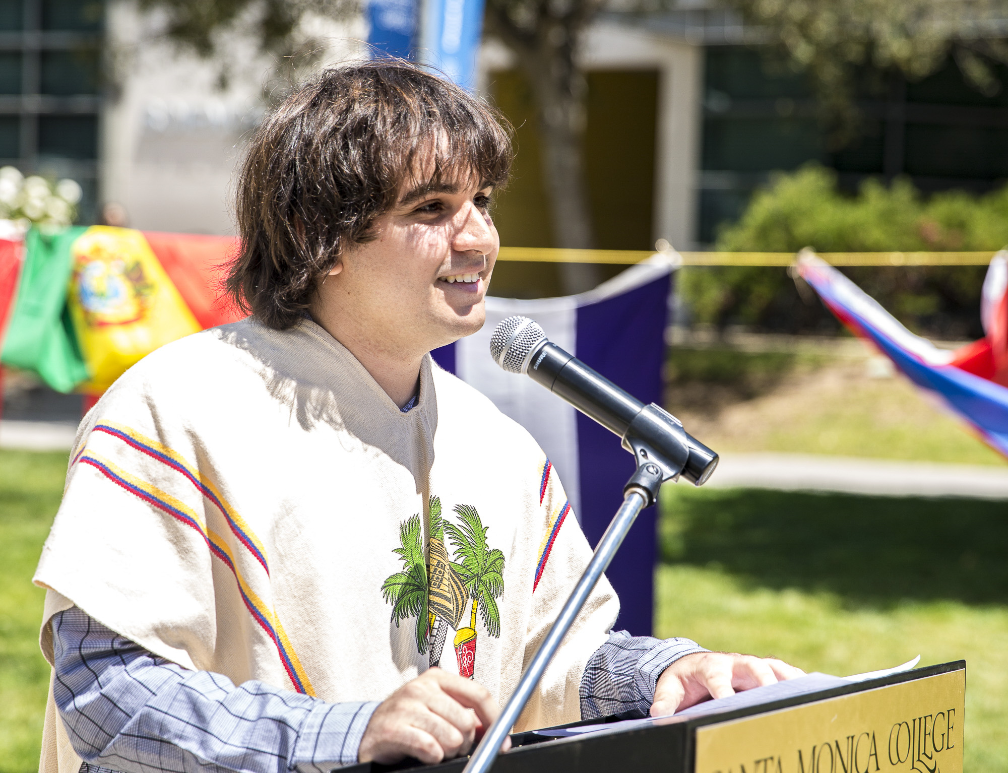 """Santa Monica College (SMC) student and President of the club """"Adelante"""" Joshua Barsky speaks to those in attendance on the importance of Cinco de Mayo and educating those that don't understand its significance during the Santa Monica College Cinco De Mayo celebration event in front of the clock tower on the SMC main campus on Thursday, May 3 2018.  This event was put together by the Santa Monica College club """"Adelante,"""" whose goal at the event was to inform students about the origins of Cinco De Mayo and put to rest the stereotypes that come with the holiday, specifically the misperception that it is a day of independence for Mexico and also that is just a drinking holiday in the United States. (Matthew Martin/Corsair Photo)"""