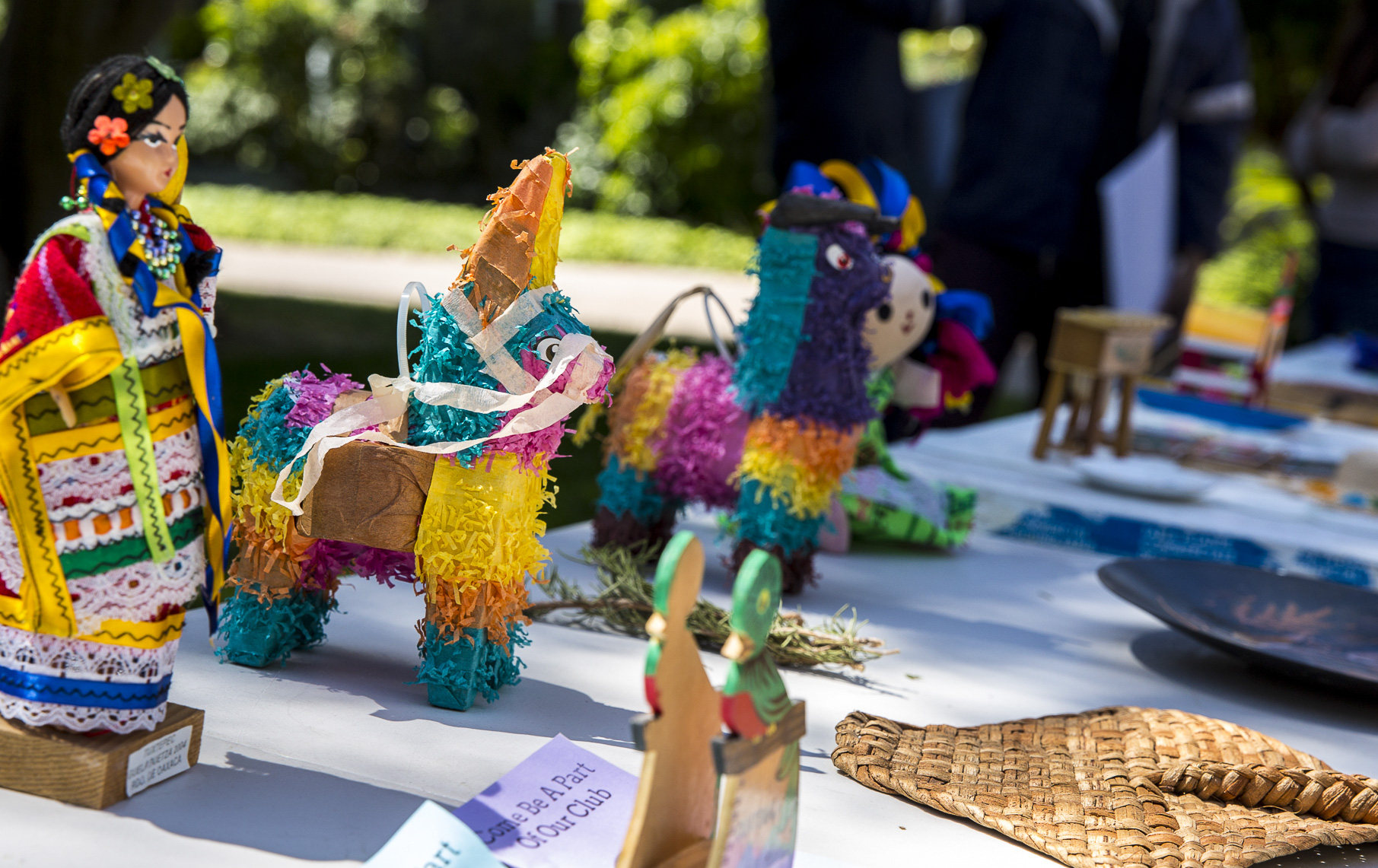 """A shot of a table with paraphernalia consisting of items that represent Cinco De Mayo and pamphlets asking students to join the Santa Monica College club that hosted the event, """"Adelante"""", in front of the Santa Monica College (SMC) Clock Tower on the SMC main campus in Santa Monica California on Thursday, May 3 2018. This event was put together by the Santa Monica College club """"Adelante,"""" whose goal at the event was to inform students about the origins of Cinco De Mayo and put to rest the stereotypes that come with the holiday, specifically the misperception that it is a day of independence for Mexico and also that is just a drinking holiday in the United States. (Matthew Martin/Corsair Photo)"""