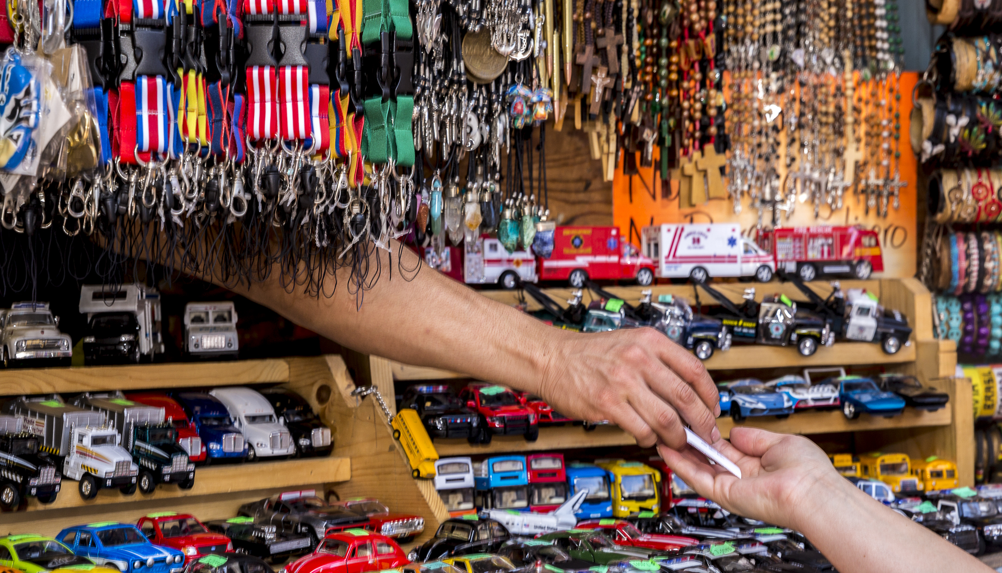 A hand appears out of one of the many stalls to give a receipt to a customer during the annual Olvera Street Cinco De Mayo celebration in Downtown Los Angeles, California on May 5, 2018. (Matthew Martin/Corsair Photo)
