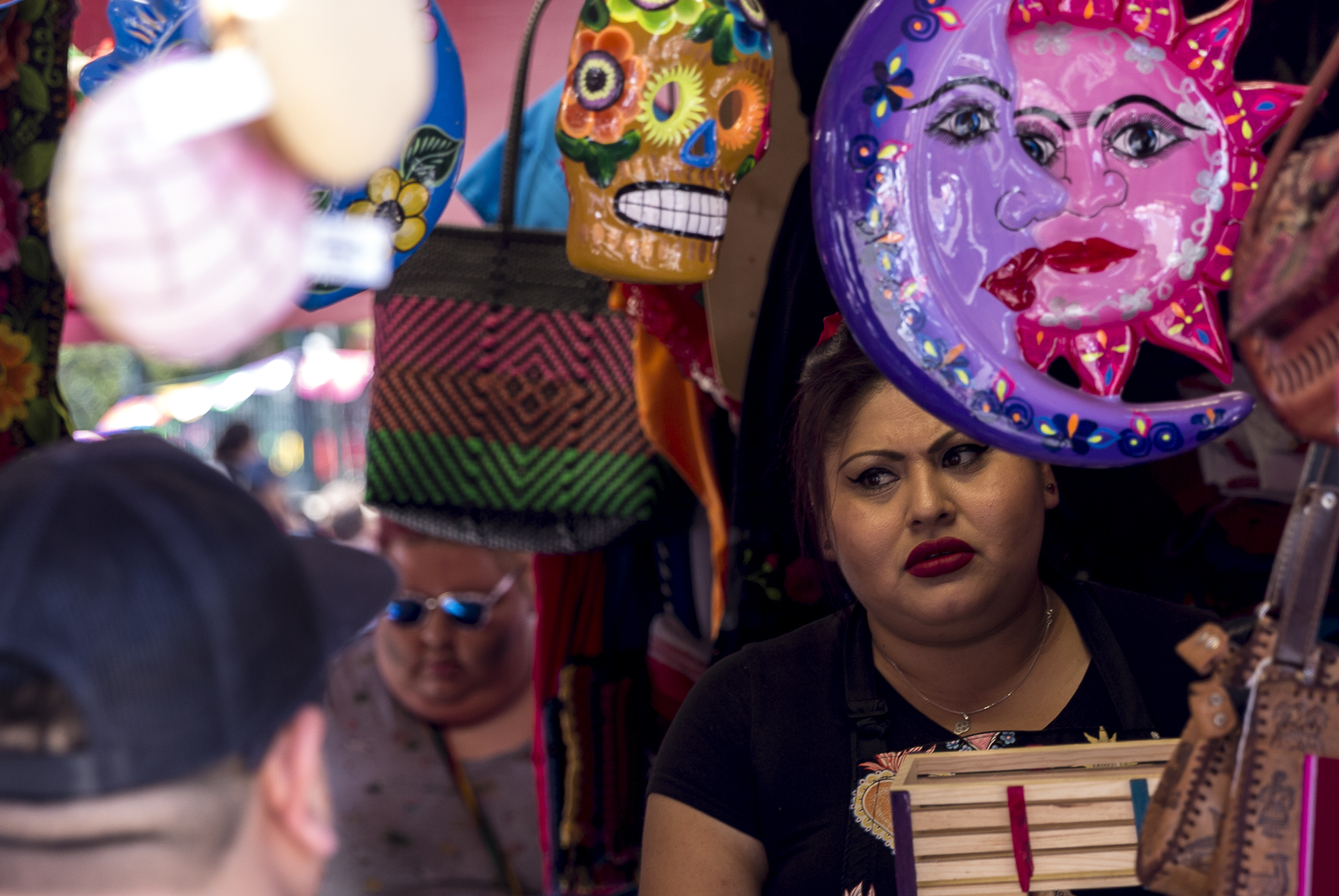 A stall owner has an argument with a customer over costs of one of her products being sold during the annual Olvera Street Cinco De Mayo celebration in Downtown Los Angeles, California on May 5, 2018. (Matthew Martin/Corsair Photo)