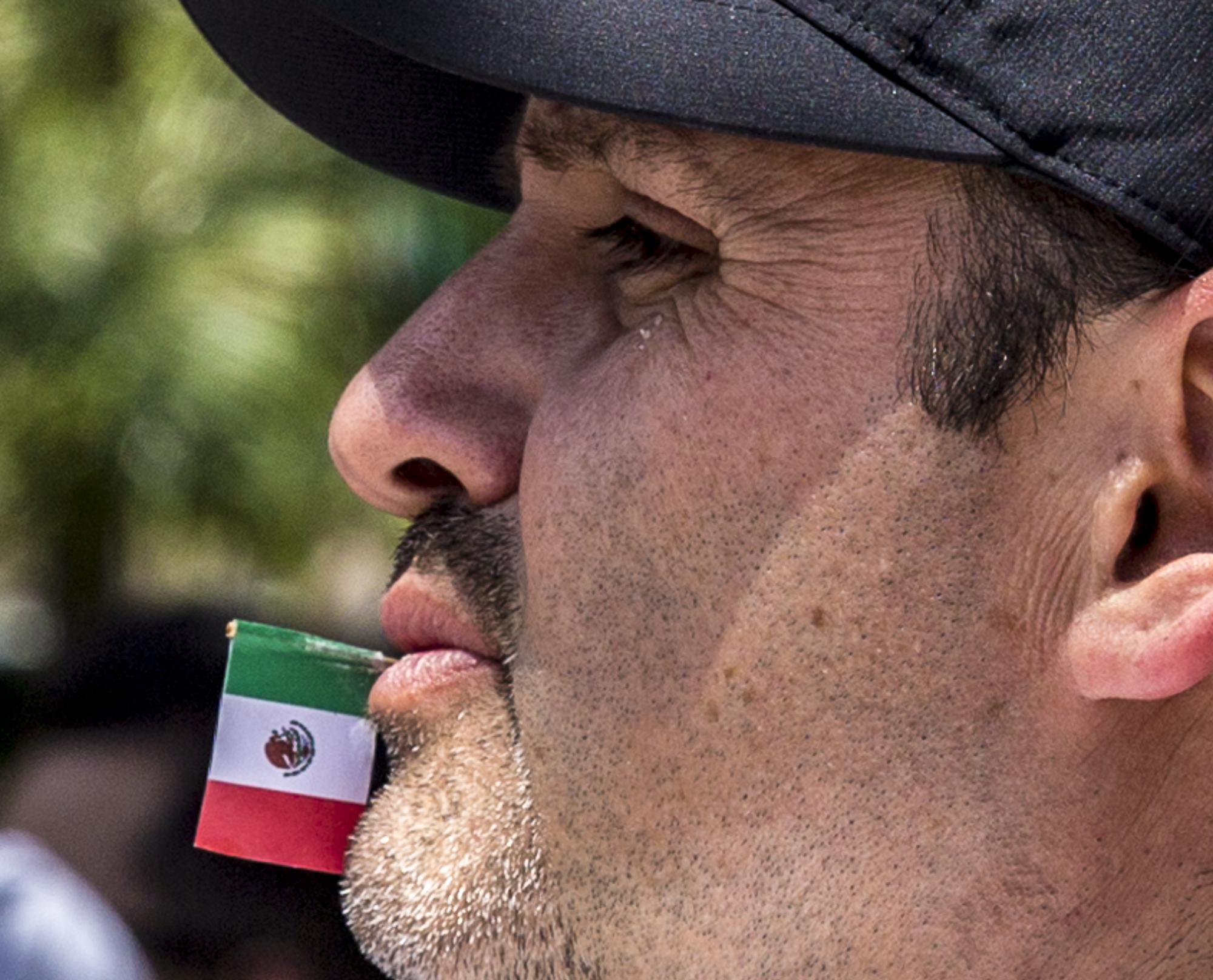 Manuel Garcia chews on a toothpick with the Mexican flag attached to the end of it during the annual Olvera Street Cinco De Mayo celebration in Downtown Los Angeles, California on May 5, 2018. (Matthew Martin/Corsair Photo)