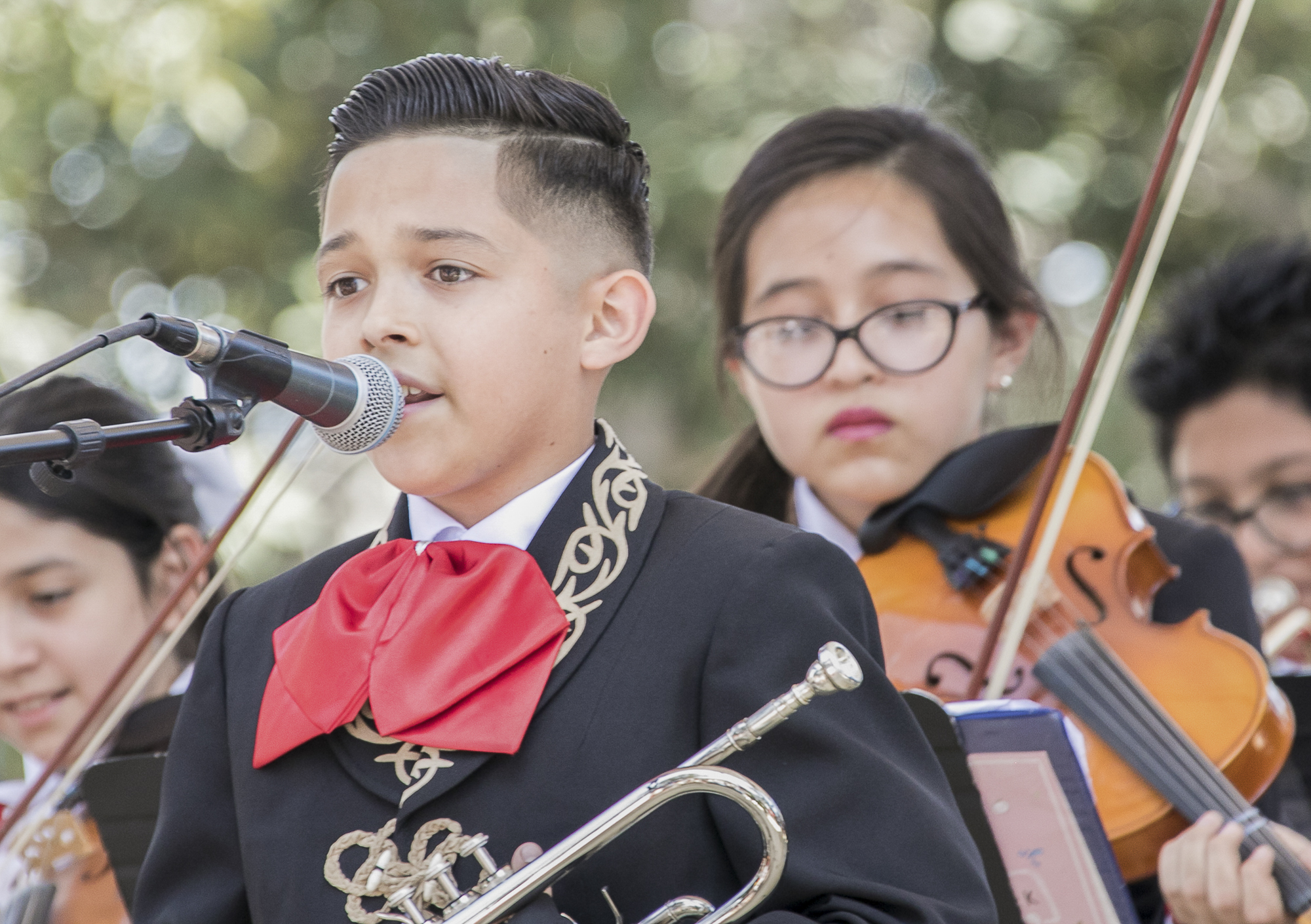 The mariachi band for Cinco De Mayo celebrations at El Pueblo de Los Angeles Historic Monument at Olvera Street on May 5th, 2018 was performed by students from a local middle school.  (Downtown, Los Angeles, California, Saturday, May 5th, 2018.) (Ashutosh Bikram Singh/Corsair Photo)