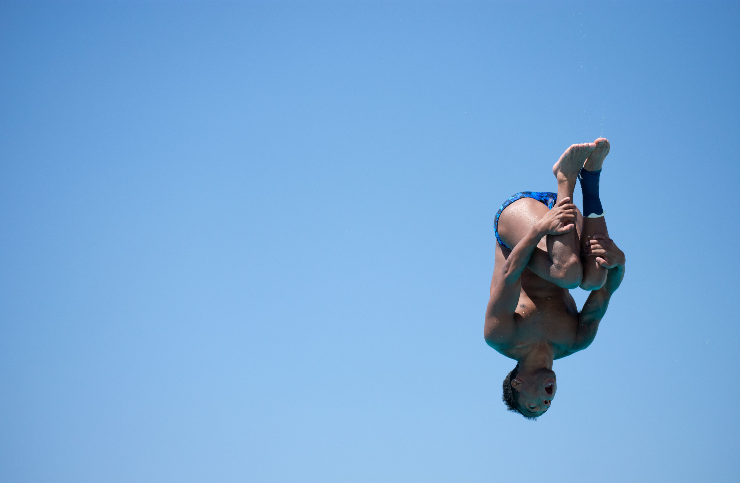Alex Watson dives from the three-meter board during practice on Thursday, April 26, 2018 at the Santa Monica Swim Center in Santa Monica, California. Watson will be headed to the CCCAA Swim and Dive State Championships, which will be held from Monday, May 3 to Saturday, May 6 to dive from the one and three-meter board. (Ethan Lauren/Corsair Photo)