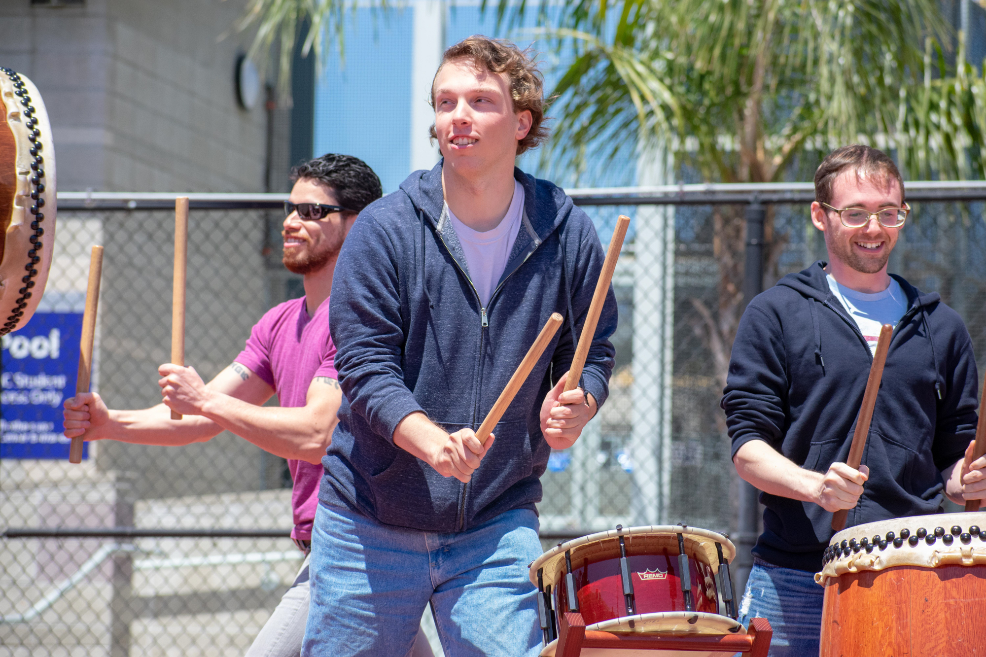 "Students Henry Jones, left, Justin Goldberg, center, and Nick Mancini, right were invited to play alongside the Taiko Center of Los Angeles to play Taiko, meaning ""large drum"" in Japanese on Thursday, May 3 at Santa Monica College in Santa Monica, California. The event was put on by the Japanese Student Association on campus. (Ethan Lauren/Corsair Photo)"