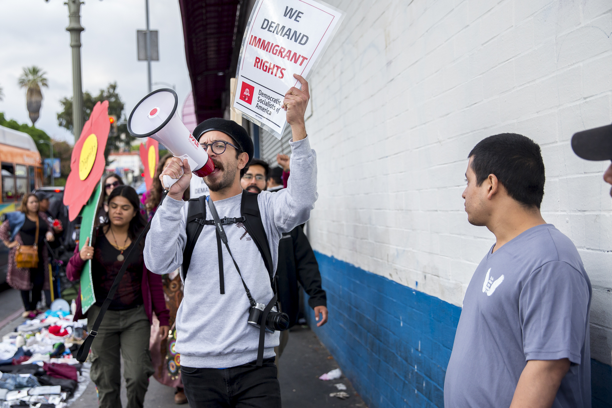 Movimiento Cosecha member Joseph Nicks leads the undocumented immigrant mother's march down Alvarado Street in downtown Los Angeles, California on Saturday, May 12 2018. The rally, organized by immigration advocacy group Movimiento Cosecha, called on the Trump administration to provide permanent protection for undocumented immigrants in the U.S. and to stop tearing mothers away from their children. (Matthew Martin/Corsair Photo)