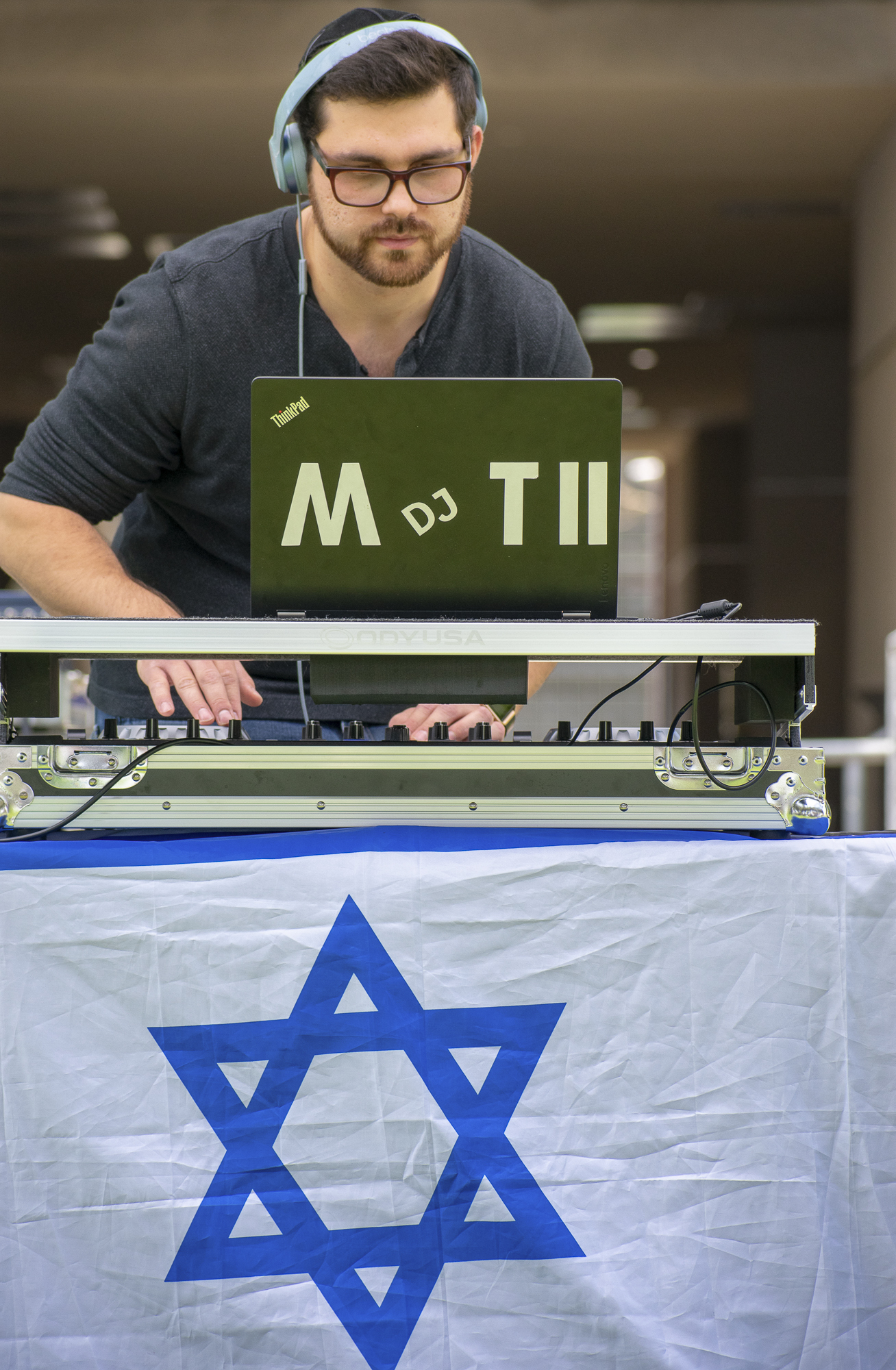 DJ Moti, otherwise known as David Leibman, a student at Santa Monica College, plays Israeli music during an event put on by the Students Supporting Israel club at Santa Monica College on Thursday, May 10 in Santa Monica, California. The event was a celebration for the 70th anniversary of Israel's independence. (Ethan Lauren/Corsair Photo)