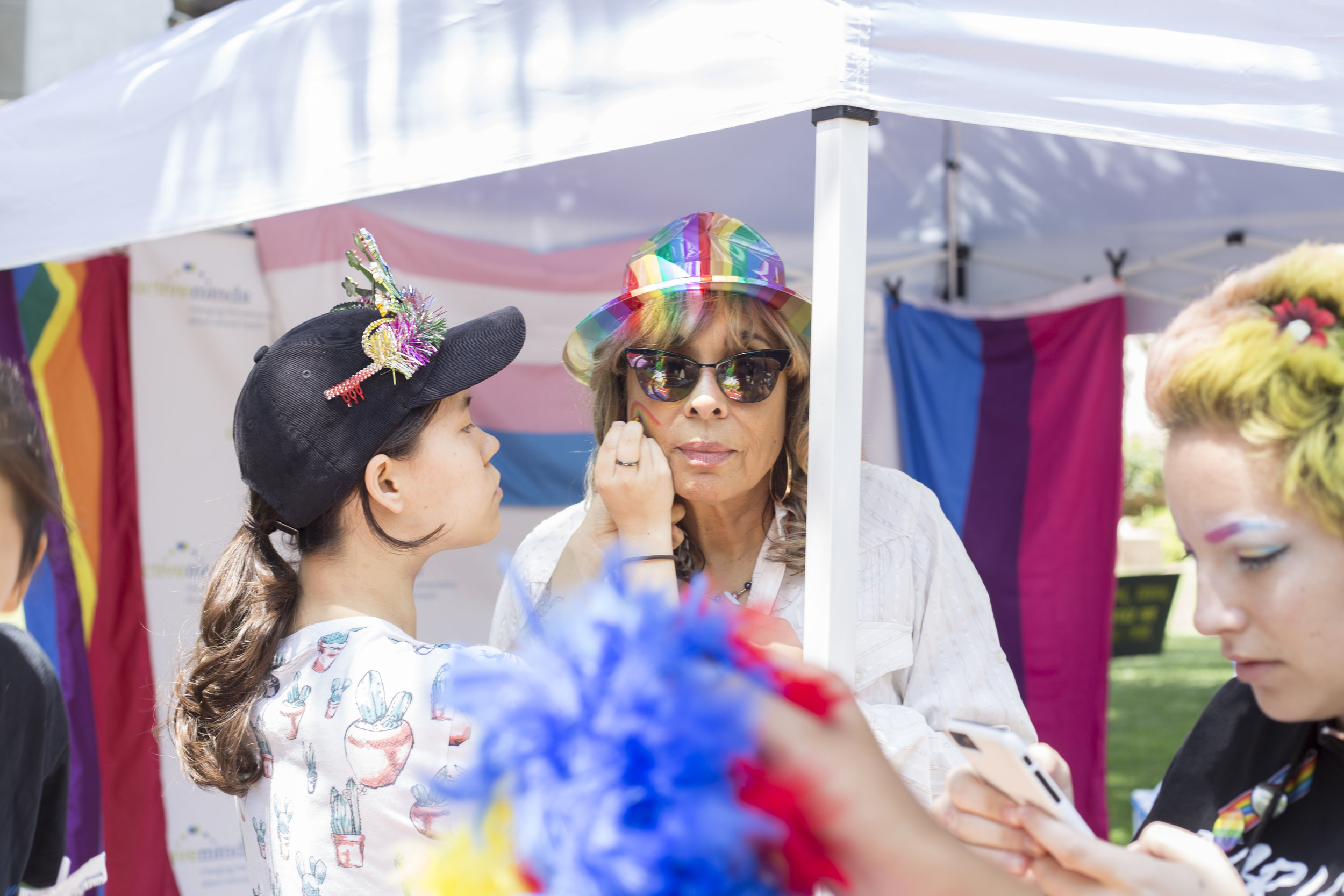 Santa Monica College (SMC) pride week event. All of the spirit: Michele Harrison from Student Life getting her face painted. SMC main campus, Santa Monica, California. Tuesday May 15, 2018. (Fernanda Rivera, Corsair Photo)