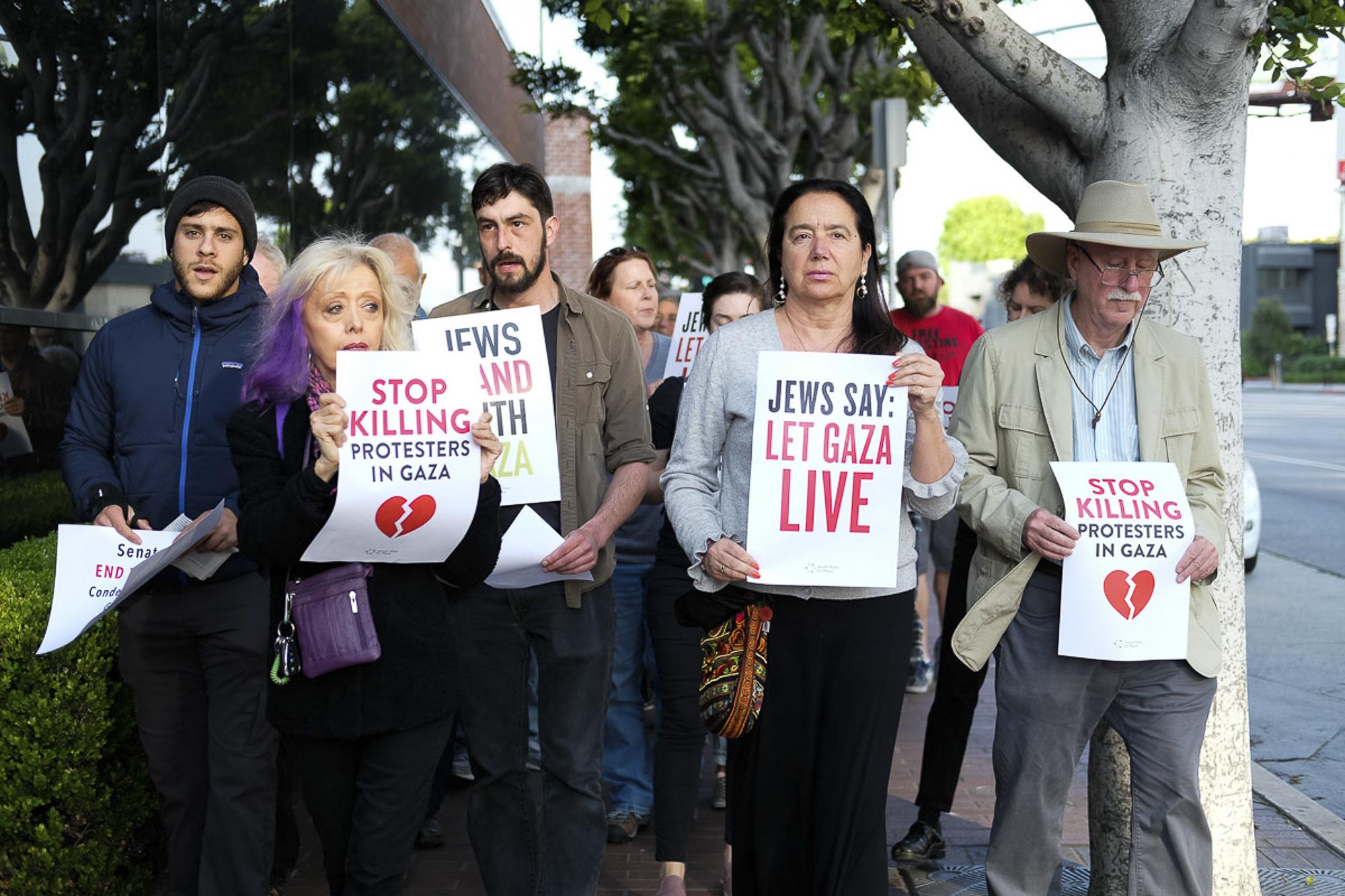 The group makes their way to where the vigil will begin in Santa Monica, California on May 18, 2018.  (Jayrol San Jose/Corsair Contributor)