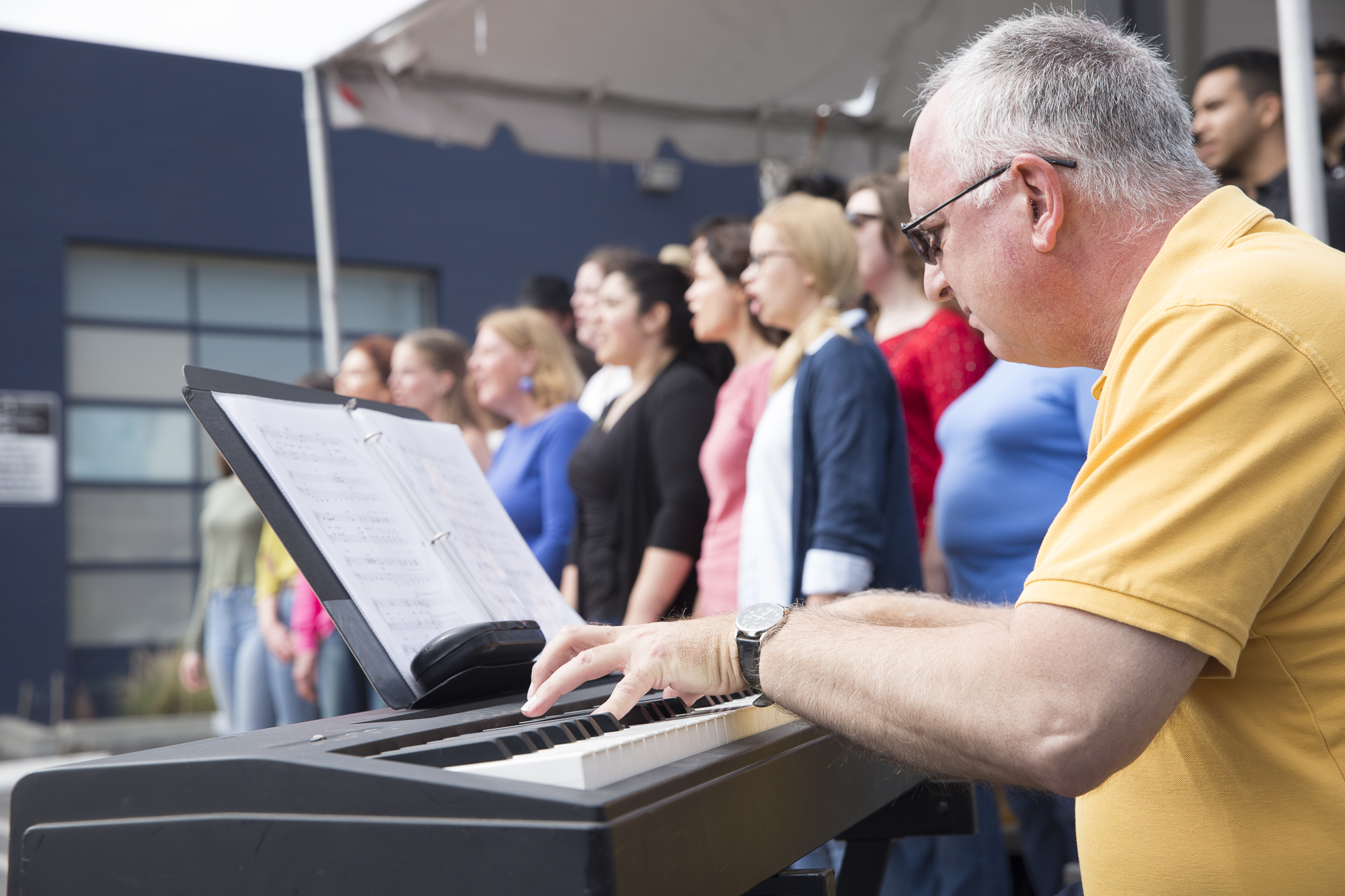 The Santa Monica College Jazz Vocal Ensemble pianist (staff accompanist) Frank Basile (right) plays classic Frank Sinatra songs on the piano during the beginning of the Pico Block Party festivities that took place at the 18th street Arts Center in Santa Monica, California on Saturday May 19, 2018. The Pico Block Party is a celebration of artists and cultures of the Pico neighborhood in Santa Monica with the festivities primarily focusing on youth artists and empowering youth voices. (Matthew Martin/Corsair Photo)