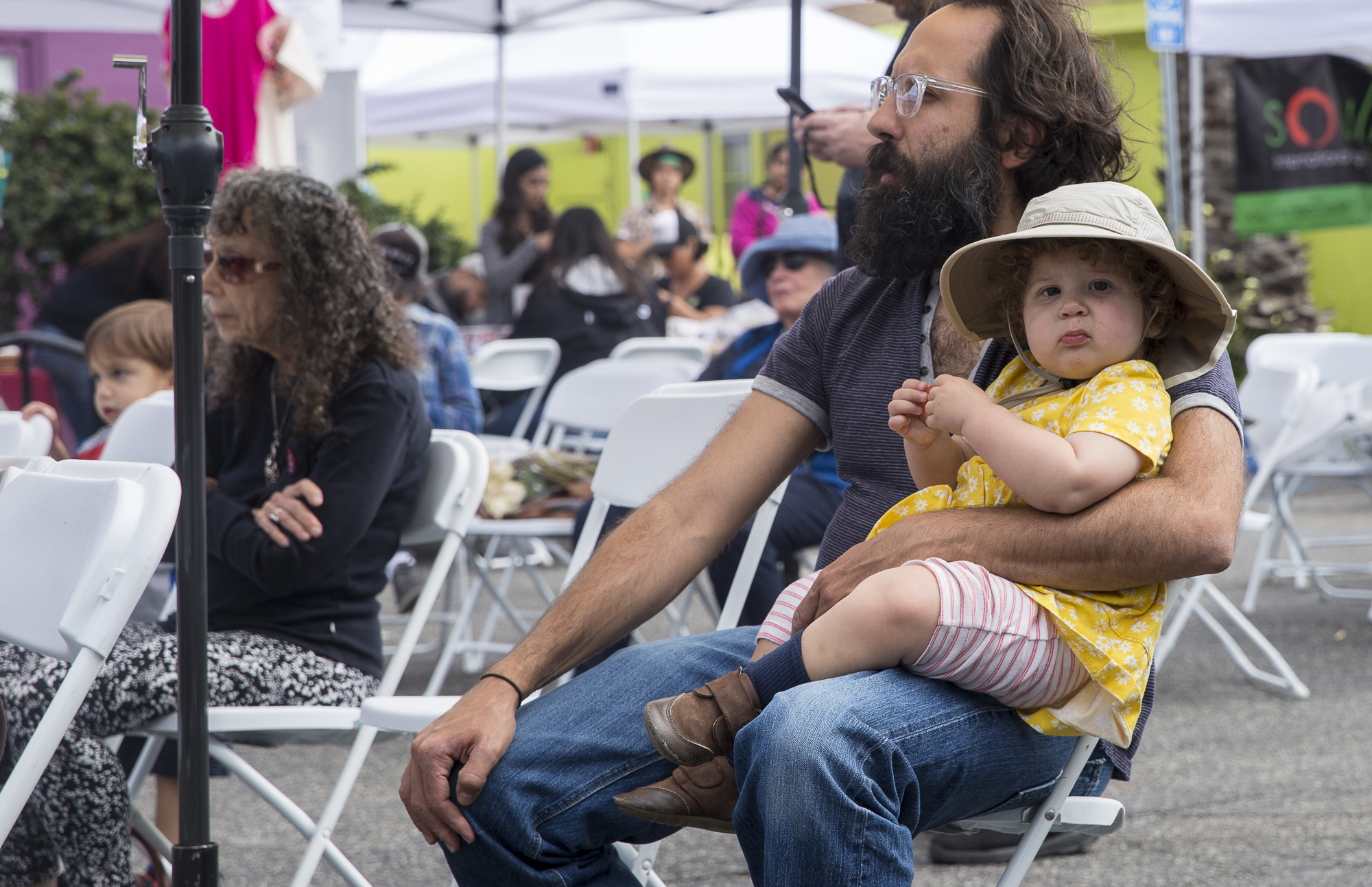 A family watches the various cultural and youth based performances during the Pico Block Party festivities that took place at the 18th street Arts Center in Santa Monica, California on Saturday May 19, 2018. The Pico Block Party is a celebration of artists and cultures of the Pico neighborhood in Santa Monica with the festivities primarily focusing on youth artists and empowering youth voices. (Matthew Martin/Corsair Photo)