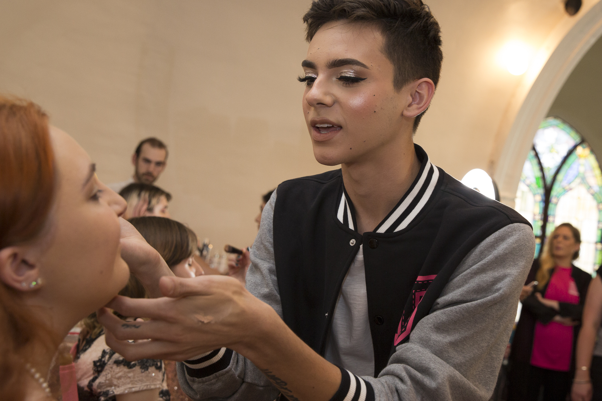 "Kate Babbe (left) gets her makeup done by Instagram influencer Ryan B. Potter (right) at the annual Westside LGBTQ+ Prom at the interfaith Church in Ocean Park in Santa Monica California on Friday May 18, 2018. The interfaith church has held ""Queer Proms"" in the past, but this year was the first that the prom's sponsor, Young People Creating Change (YPCC), partnered with the Princess Project Los Angeles (PPLA), Benefit Cosmetics, and Teen Vogue to produce the event. (Matthew Martin/Corsair Photo)"