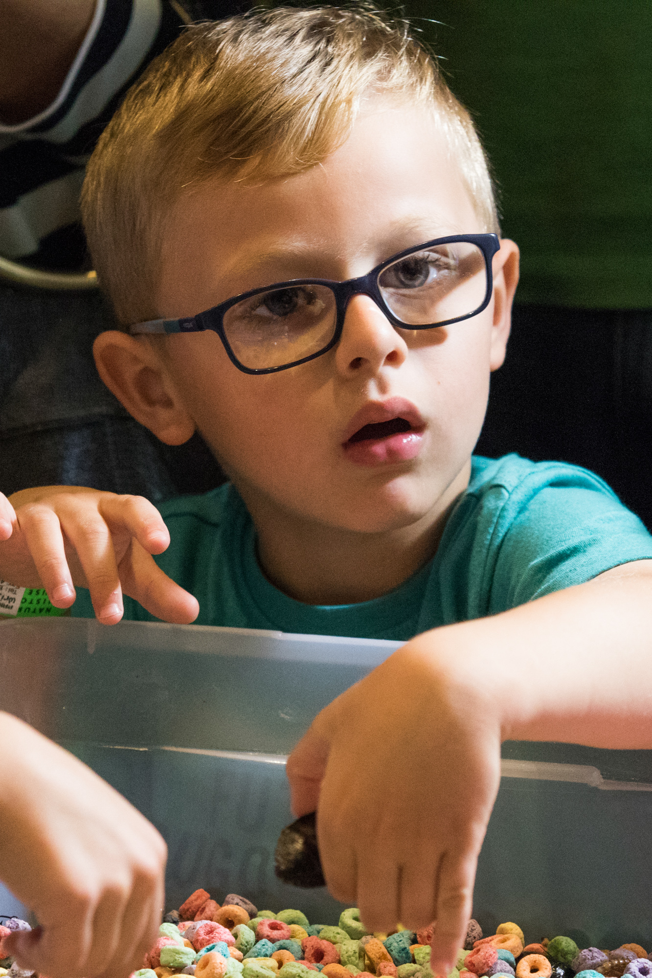 A young attendee of the Los Angeles Natural History Museums 32nd annual Bug Fair stares in awe as a Diana Terranova puts a tarantuala in her mouth and lets it crawl out of it at the Los Angeles Natural History Museums 32nd annual Bug Fair on May 19, 2018. (Zane Meyer-Thornton/Corsair Photo