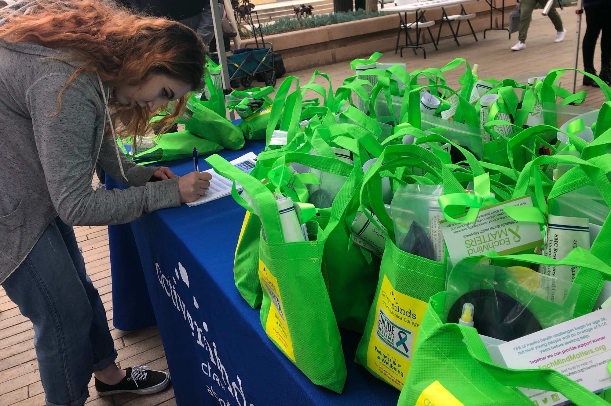 Student Skyler Stark signing up to get a free self-care kit, at Active Minds of SMC's event on Thursday, May 24th, 2018 at Santa Monica College, in Santa Monica, California. (Jennifer Nystrom/Corsair Photo)
