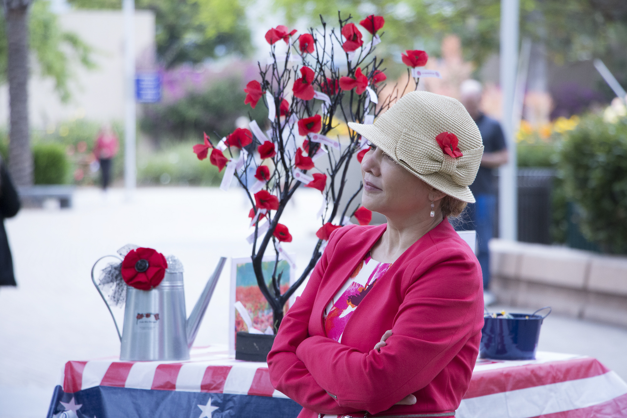 Cynthia Gonzales, a professor at Santa Monica College and a member of the American Legion Auxillary, stood off to the side, in front of a display with red poppys during a speech at the Memorial Day Commemoration on Thursday, May 25 in Santa Monica, California. (Wilson Gomez/Corsair Photo)
