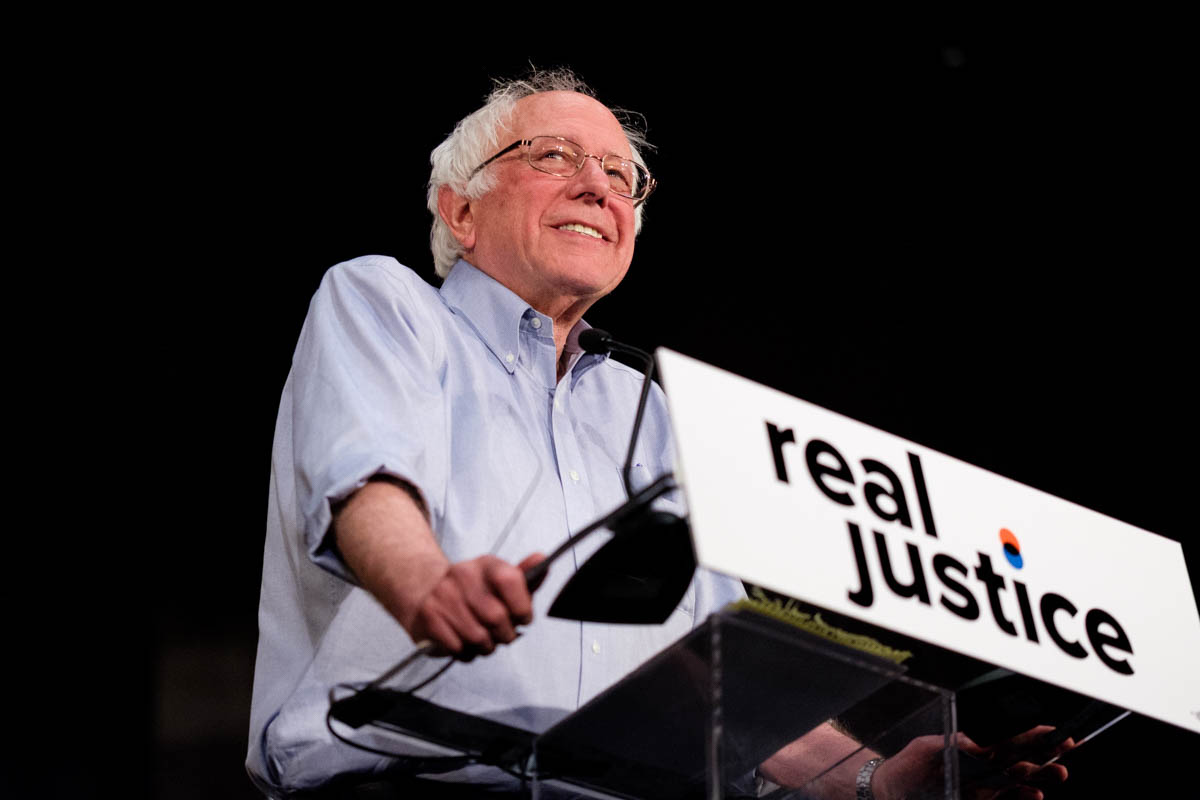 "Senator Bernie Sanders smiles as the crowd roars and cheers him on as he takes the podium at the ""Rally for Justice"" in Los Angeles, California on June 2, 2018. (Jayrol San Jose/ Corsair Contributor)"