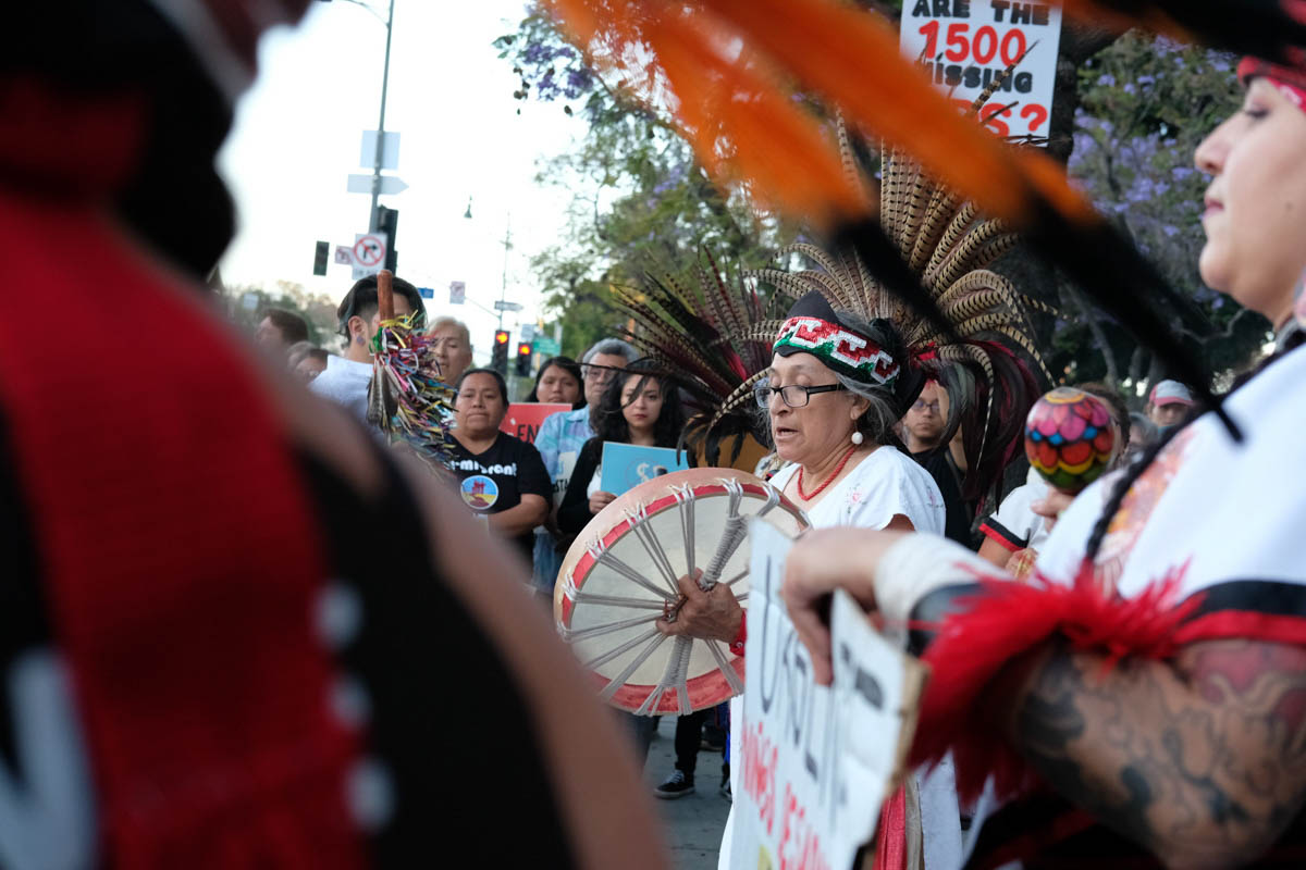 Protesters perform an Aztec tribal dance during the Justice for Claudia Vigil in Los Angeles, California on June 1, 2018. (Jayrol San Jose/Corsair Contributor)