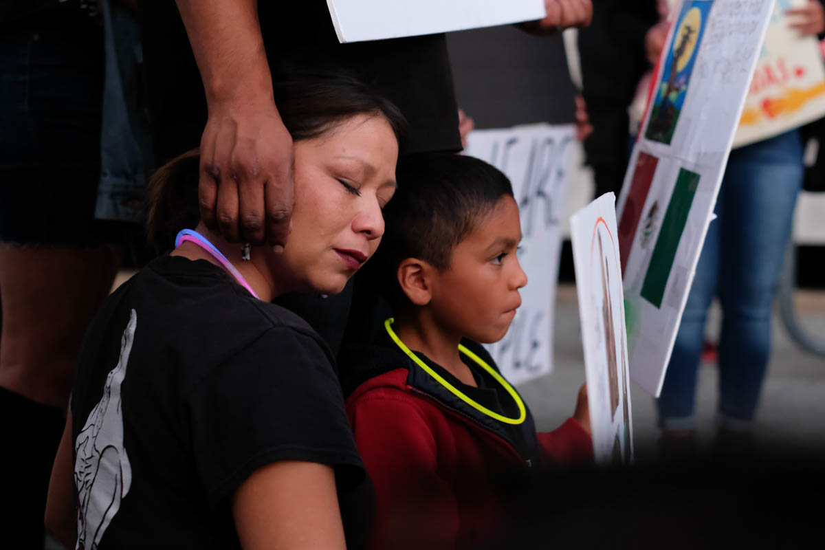 A woman gets comfort from her family during the Justice for Claudia vigil in Los Angeles, California on June 1, 2018.(Jayrol San Jose/Corsair Contributor)
