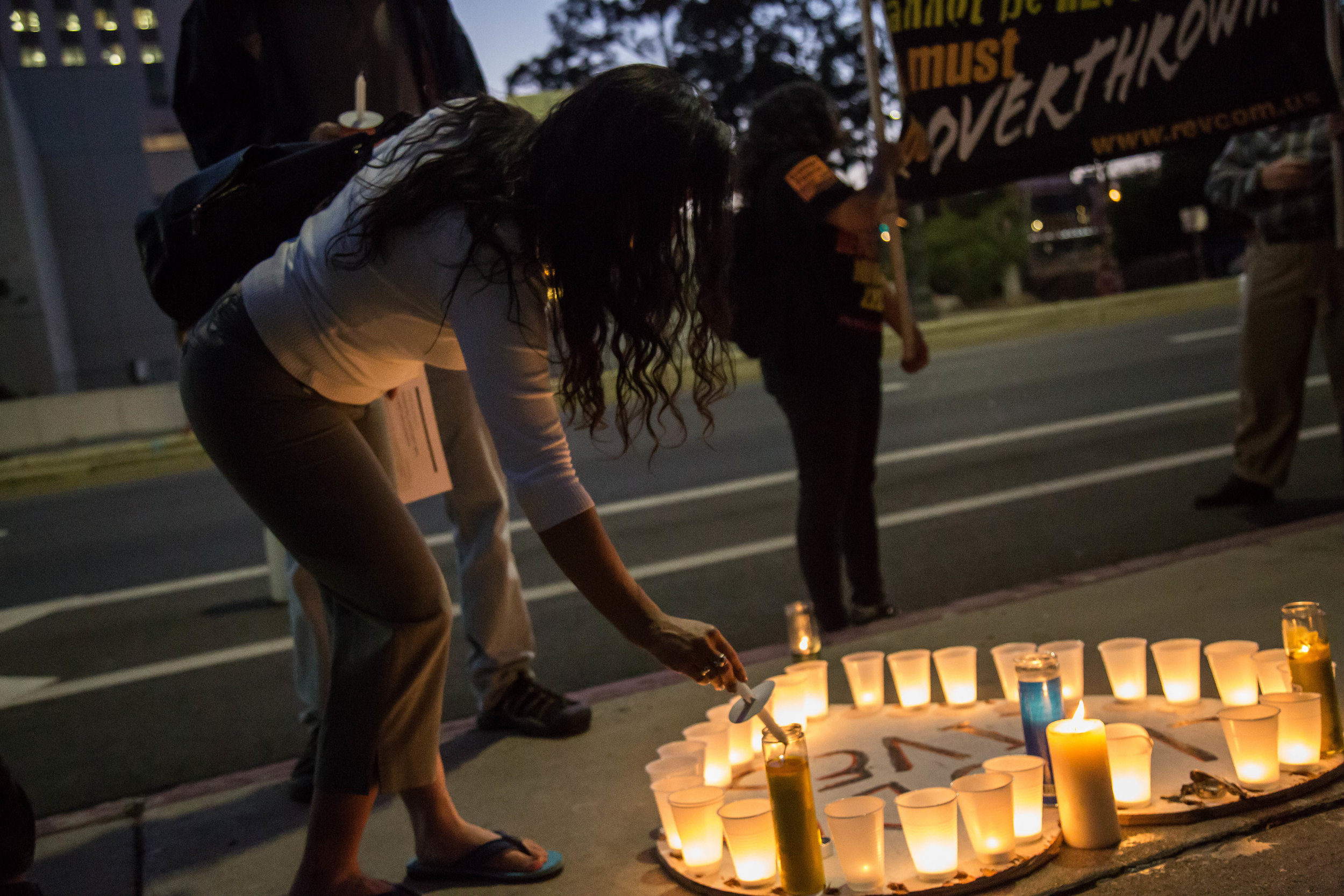 """Participants of """"Justice for Claudia and All kidnapped Indigenous children!"""" lights up their candle to demand justice for Claudia Patricia Gómez González in front of the United States Citizenship and Immigration building in Downtown Los Angeles, California on June 1st, 2018. (Yuki Iwamura/Corsair Contributor)"""
