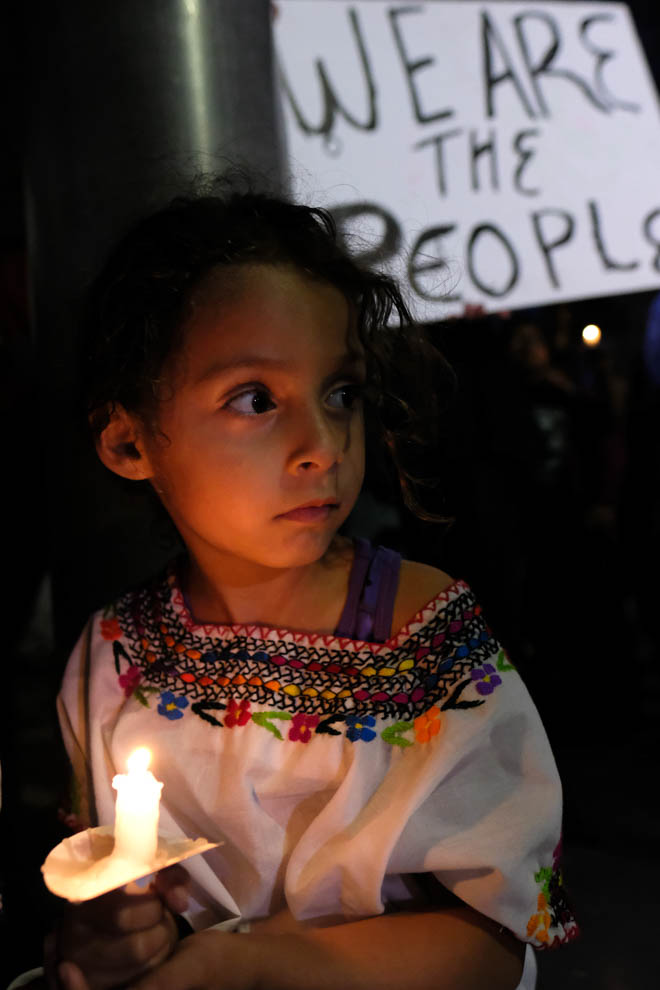 A little girl holds a vigil candle during the Justice for Claudia Vigil in Los Angeles, California on Saturday June 1, 2018.(Jayrol San Jose/Corsair Contributor)