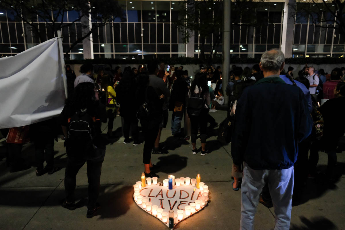 Proteters gather in front of the United States Citizenship and Immigration Service building in Los Angeles, CALIF on June 1, 2018 for a vigil for the lost life of Claudia Gomez. She was shot by border patrol agents  while trying to cross into the United States.(Jayrol San Jose/Corsair Contributor)