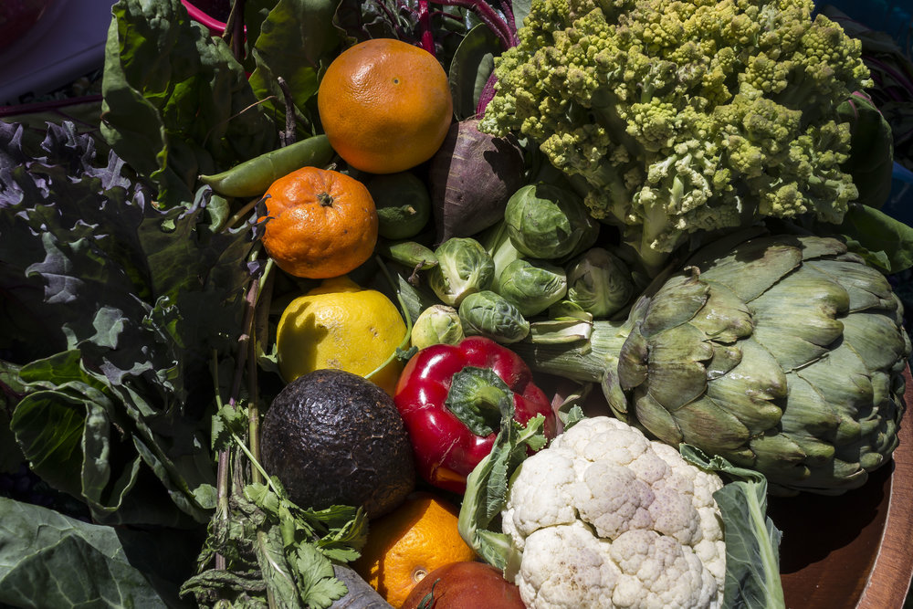 Fresh products given away to students at the Farmers Market. Earth Week started with 'Students Feeding Students' Free Farmers Market & Food Demos on Monday, April 16, 2018. At Santa Monica College, Santa Monica California. (Emeline Moquillon/Corsair Photo)