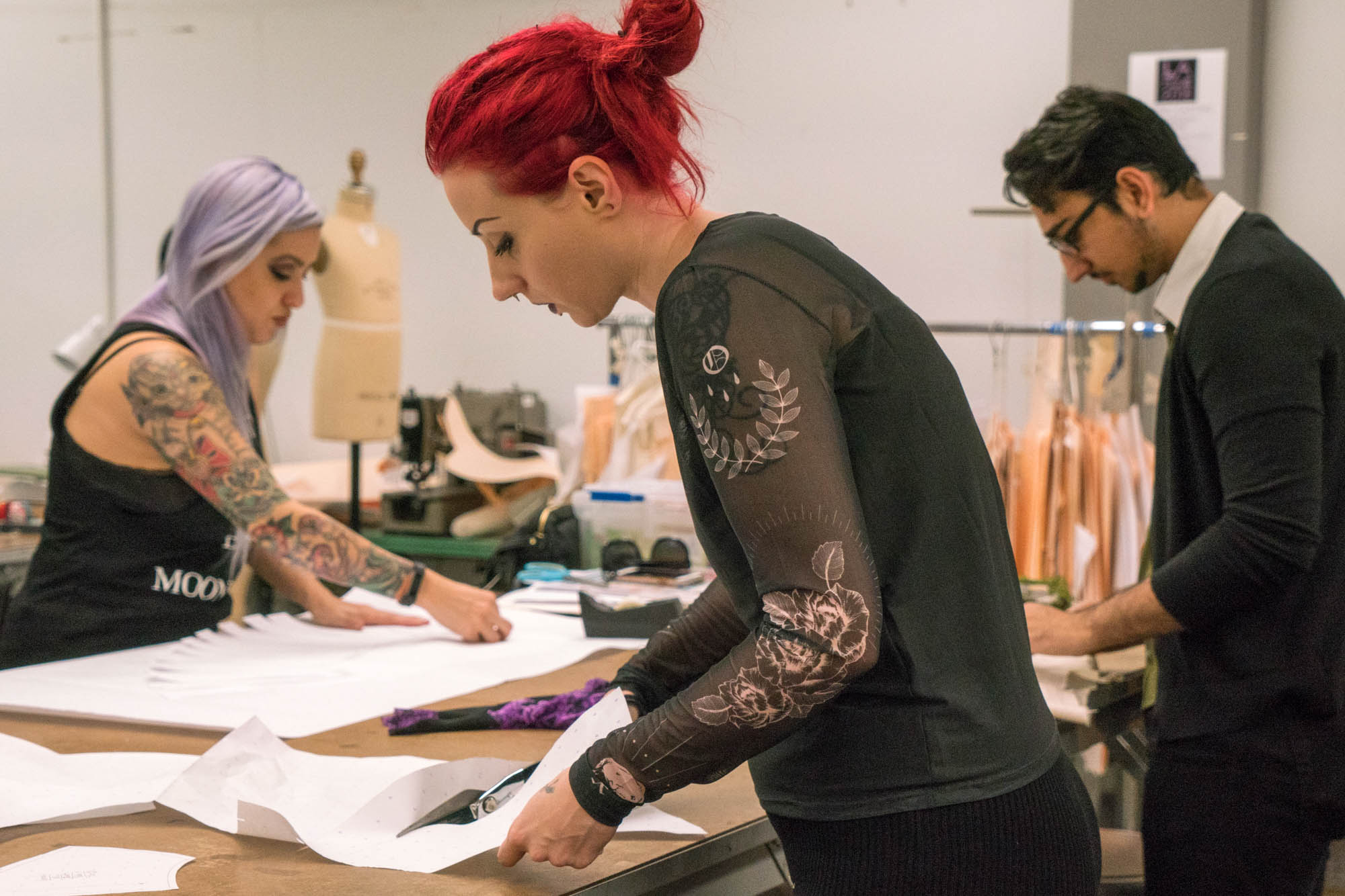 Abby Kahan, Shayan Pashai, and Sarah Lucier (left to right) working hard on their patterns. Photo by Rea Sohn/Corsair Contributor