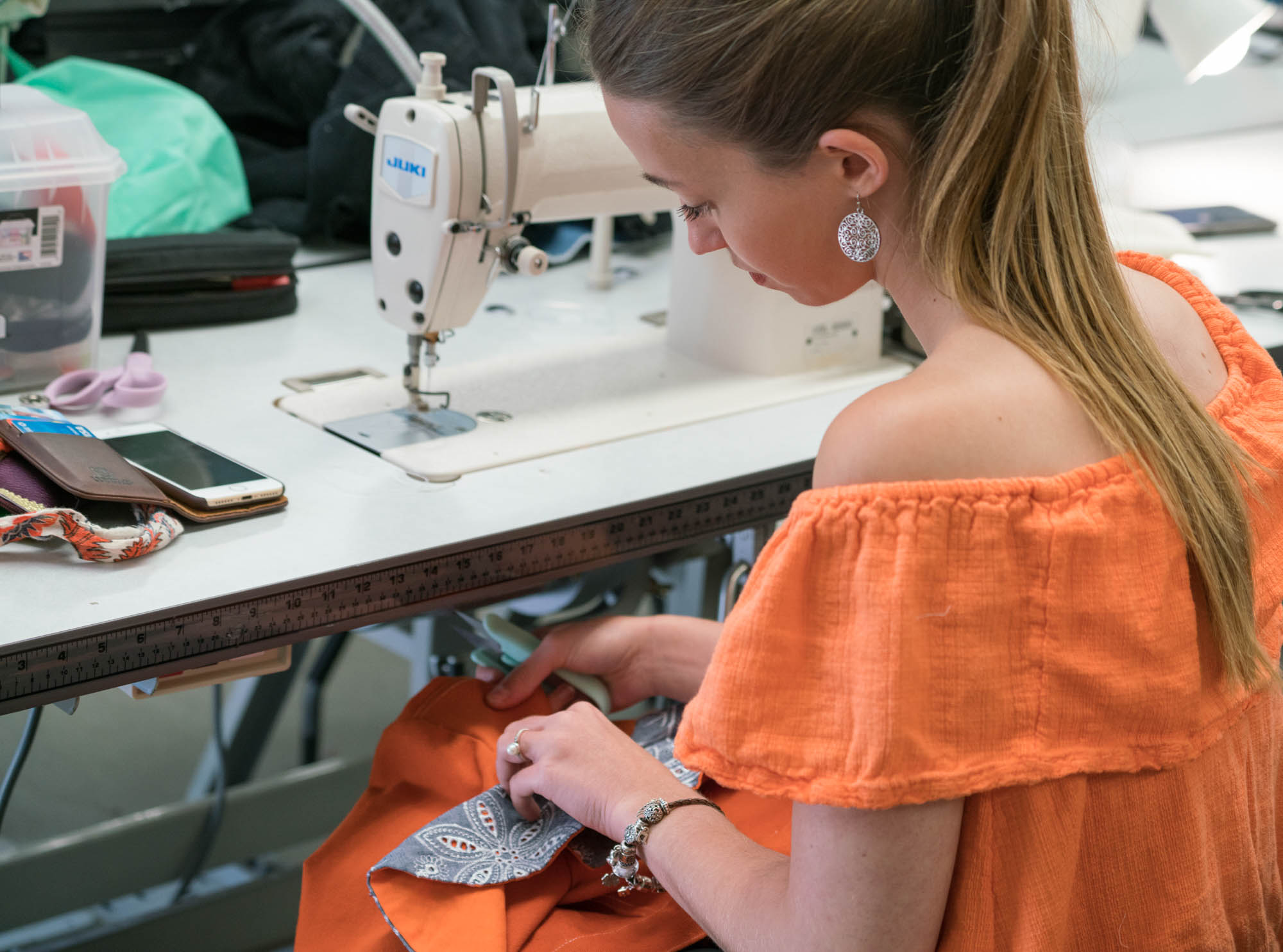 Emilie Geldreich doing a final touch of her jacket for the fashion show. Photo by Rea Sohn/Corsair Contributor