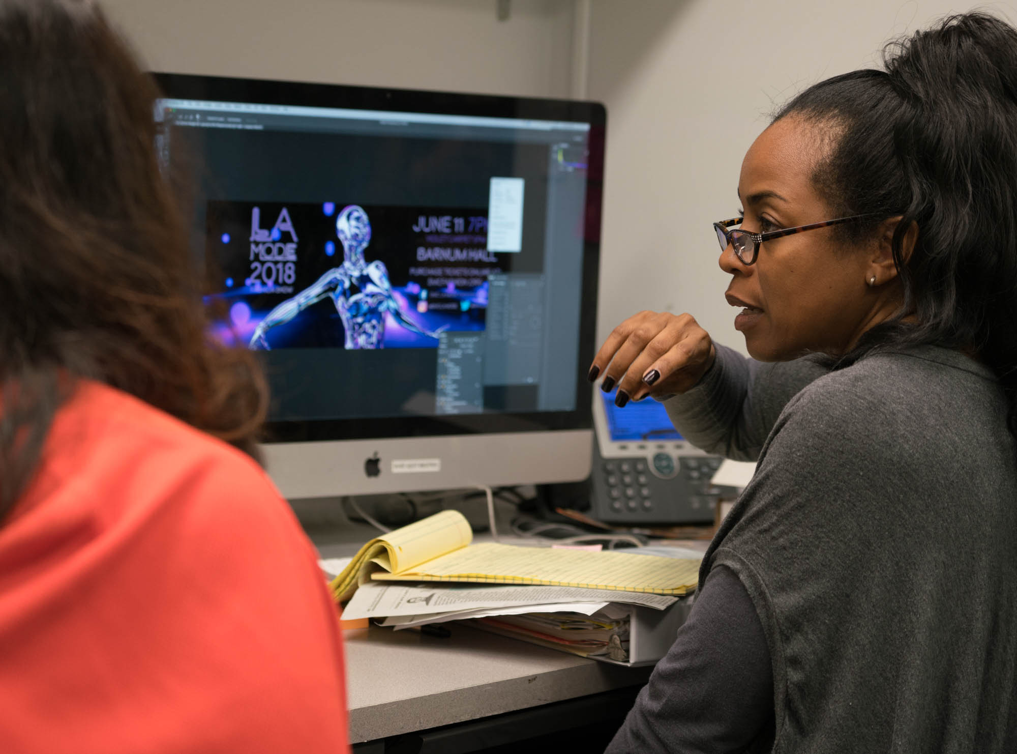Prof. La Tanya Louis( left) and Tracy going over the billboard design layout. Photo by Rea Sohn/Corsair Contributor