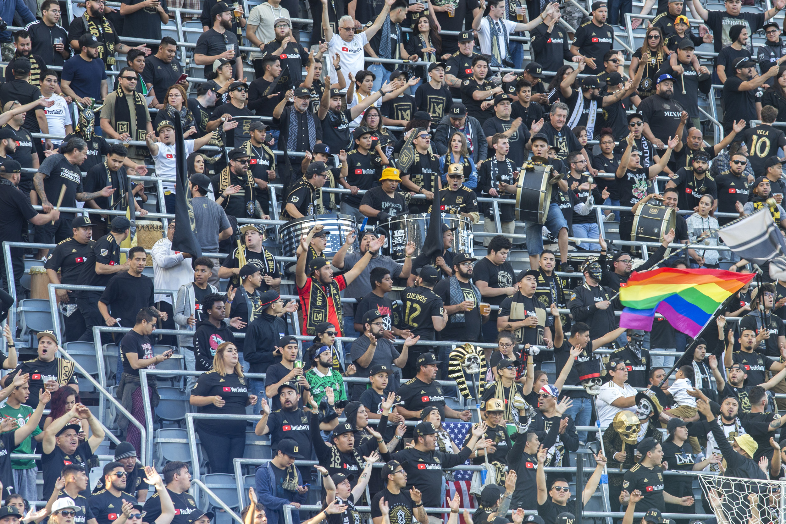 Fans cheer for the Los Angeles Football Club before their second home match of the season against the Minnesota United Football Club while sporting an LGBTQ flag. There was an incident in the teams first game where fans were shouting homophobic slurs. LAFC won the game 2-0 (Zane Meyer-Thornton/Corsair Photo)