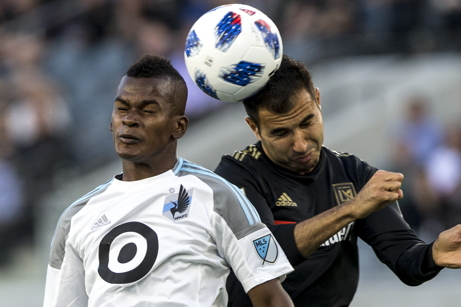 Minnesota United Football Club (MUFC) forward Darwin Quintero (left) battles for a header against Los Angeles Football Club (LAFC) defender Steven Beitashour (right) during their match at Banc of California Stadium on May 9, 2018 where the LAFC won 2-0. (Zane Meyer-Thornton/Corsair Photo)