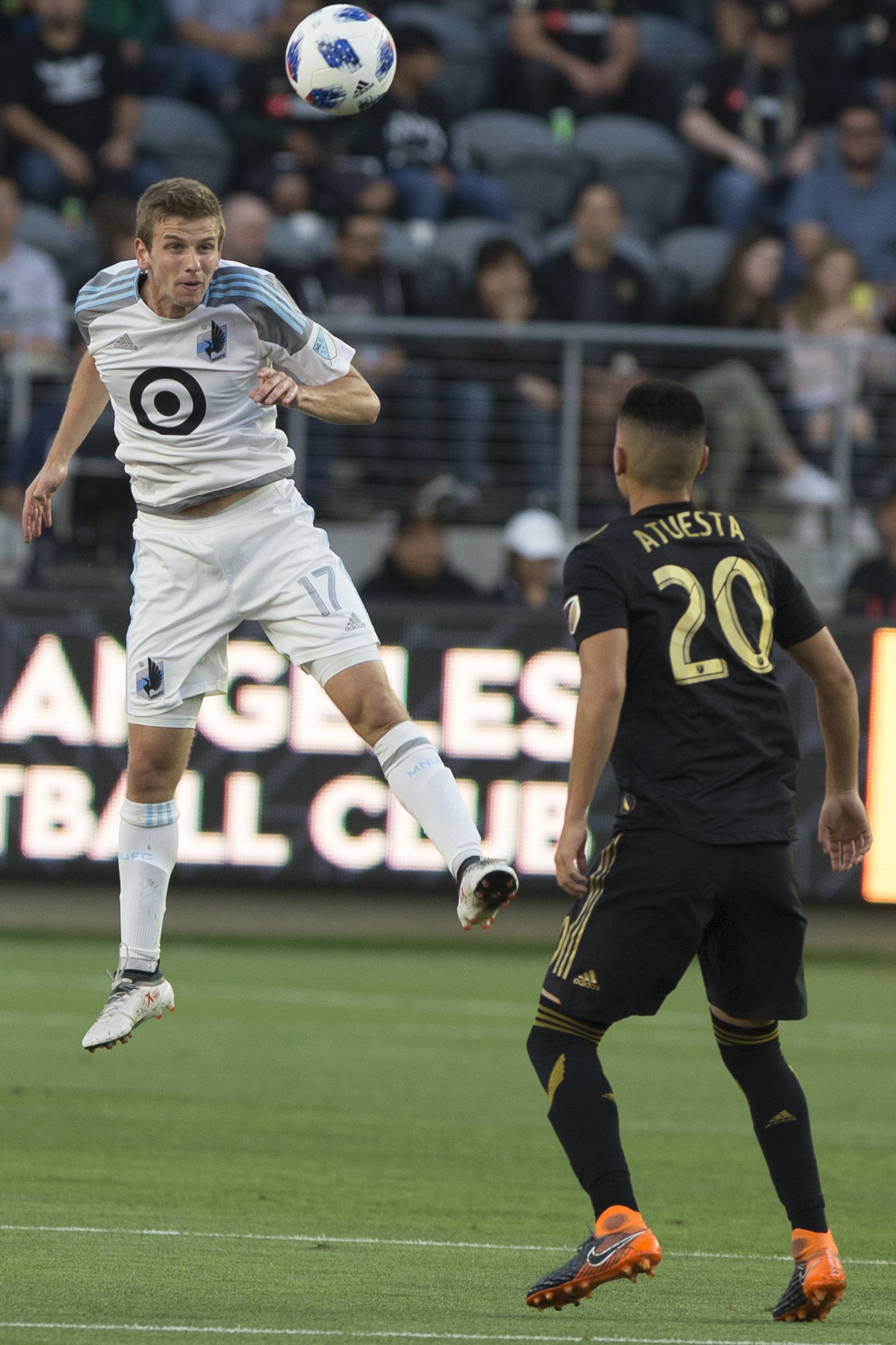 Minnesota United Football Club (MUFC) midfileder Collin Martin (17, left) goes for a header while Los Angeles Football Club (LAFC) midfielder Eduard Atuesta (20, right) anticipates where the ball will go during their match at Banc of California Stadium on May 9, 2018 where the LAFC won 2-0. (Zane Meyer-Thornton/Corsair Photo)
