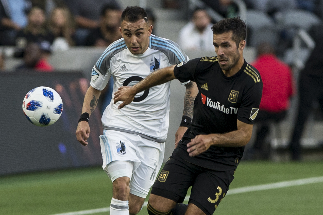 Minnesota United Football Club (MUFC) midfielder Miguel Ibarra (10, left) battles Los Angeles Football Club (LAFC) midfileder Benny Feilhaber for the ball during their match at Banc of California Stadium on May 9, 2018 where the LAFC won 2-0. (Zane Meyer-Thornton/Corsair Photo)