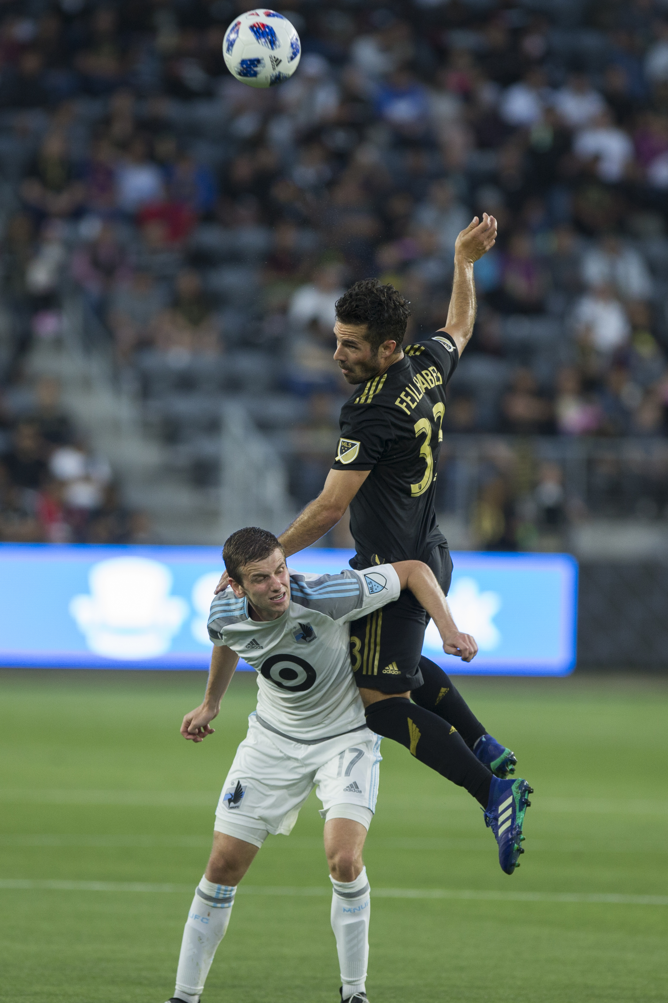 Minnesota United Football Club (MUFC) midfielder Collin Martin (17, left) headers the ball away from Los Angeles Football Club (LAFC) midfielder Benny Feilhaber (33, right) during their match at Banc of California Stadium on May 9, 2018 where the LAFC won 2-0. (Zane Meyer-Thornton/Corsair Photo)