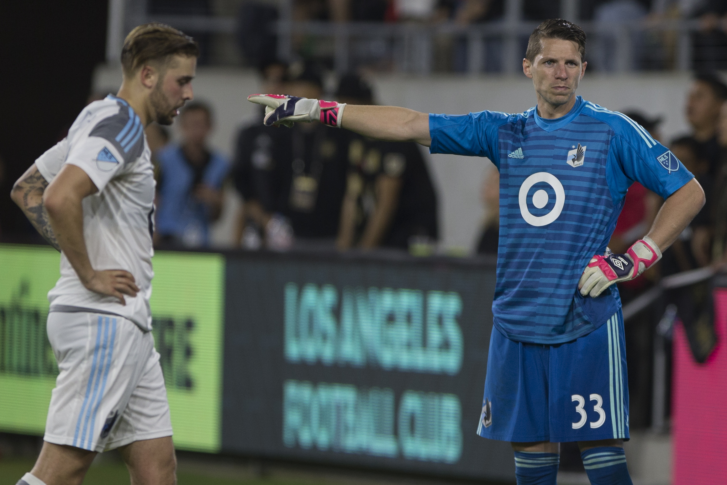 Minnesota United Football Club goalie Booby Shuttleworth (33, right) blames his teammates for a lack of defense during their match against the Los Angeles Football Club  at Banc of California Stadium on May 9, 2018 where the LAFC won 2-0. (Zane Meyer-Thornton/Corsair Photo)