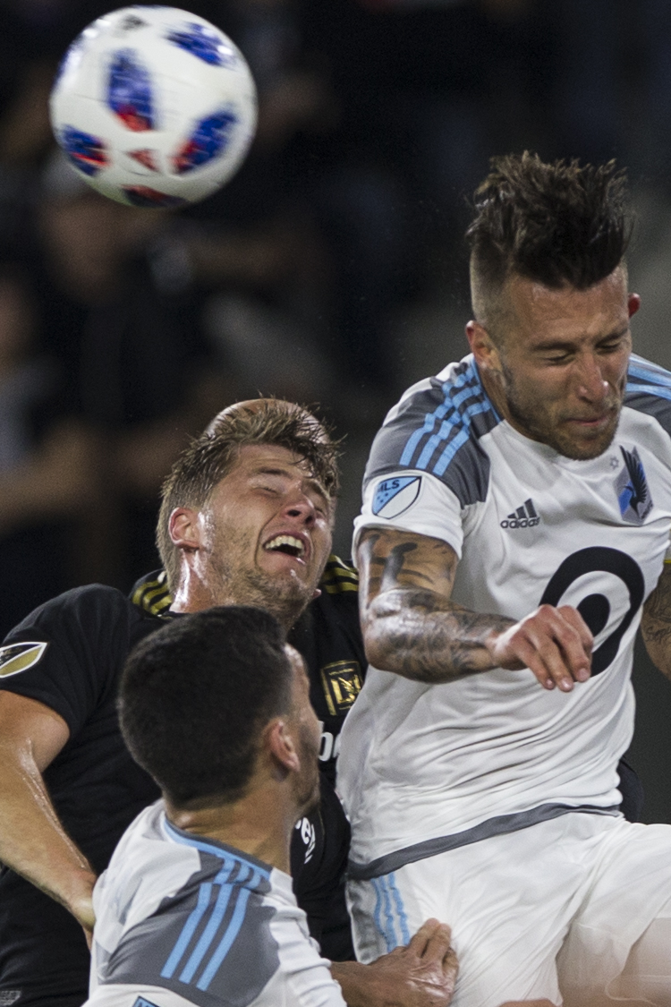 Los Angeles Football Club (LAFC) defender Walker Zimmerman (black, left) battles for a header against Minnesota United Football Club Captain Defender Francisco Calvo (white, right) during their match at Banc of California Stadium on May 9, 2018 where the LAFC won 2-0. (Zane Meyer-Thornton/Corsair Photo)