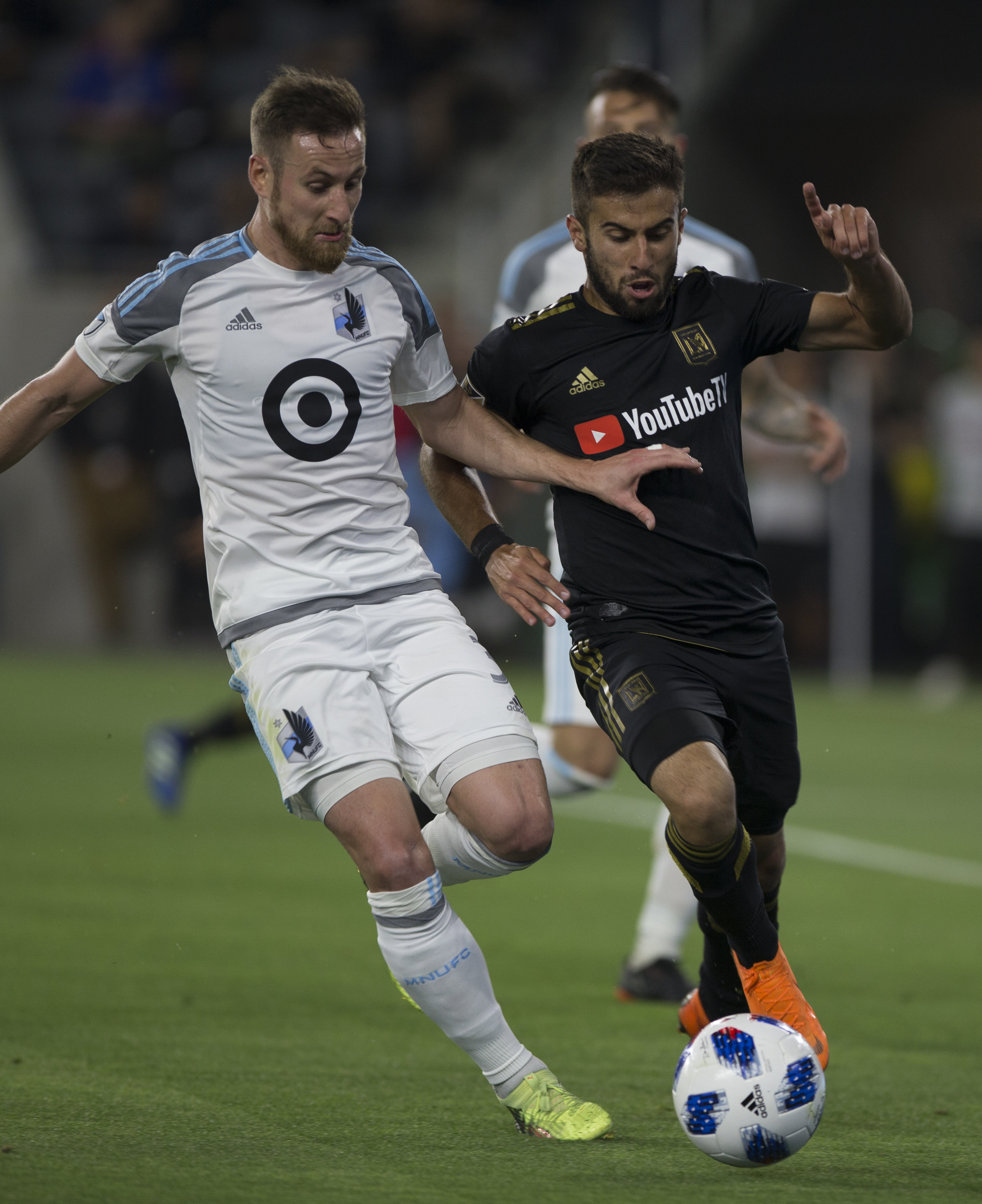 Minnesota United Football Club defender Jerome Thiesson (3, left) battles for the ball against Los Angeles Football Club forward Diego Rossi (9, right) during their match at Banc of California Stadium on May 9, 2018 where the LAFC won 2-0. (Zane Meyer-Thornton/Corsair Photo)