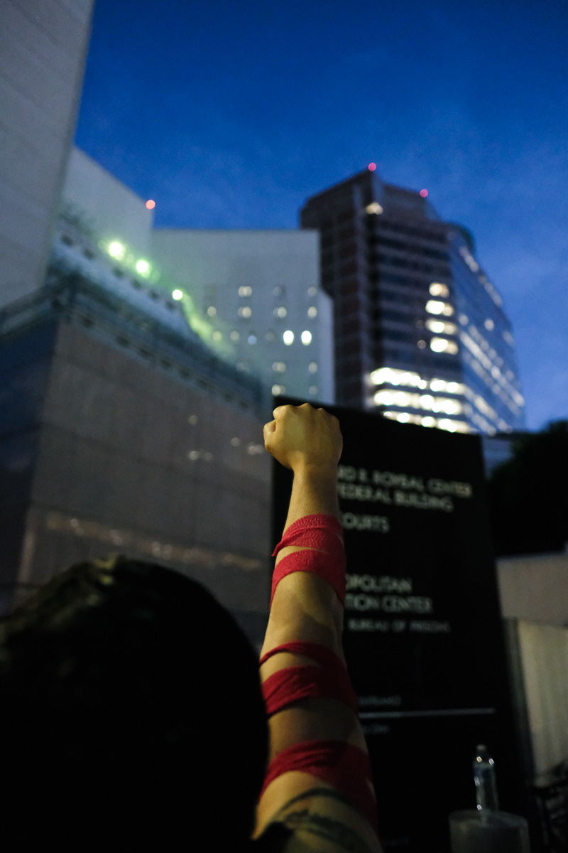 Protester holds their first up to the detention center to show the detainees that they are there for them in Los Angeles, CALIF on June 14, 2018. (Photo by Jayrol San Jose)