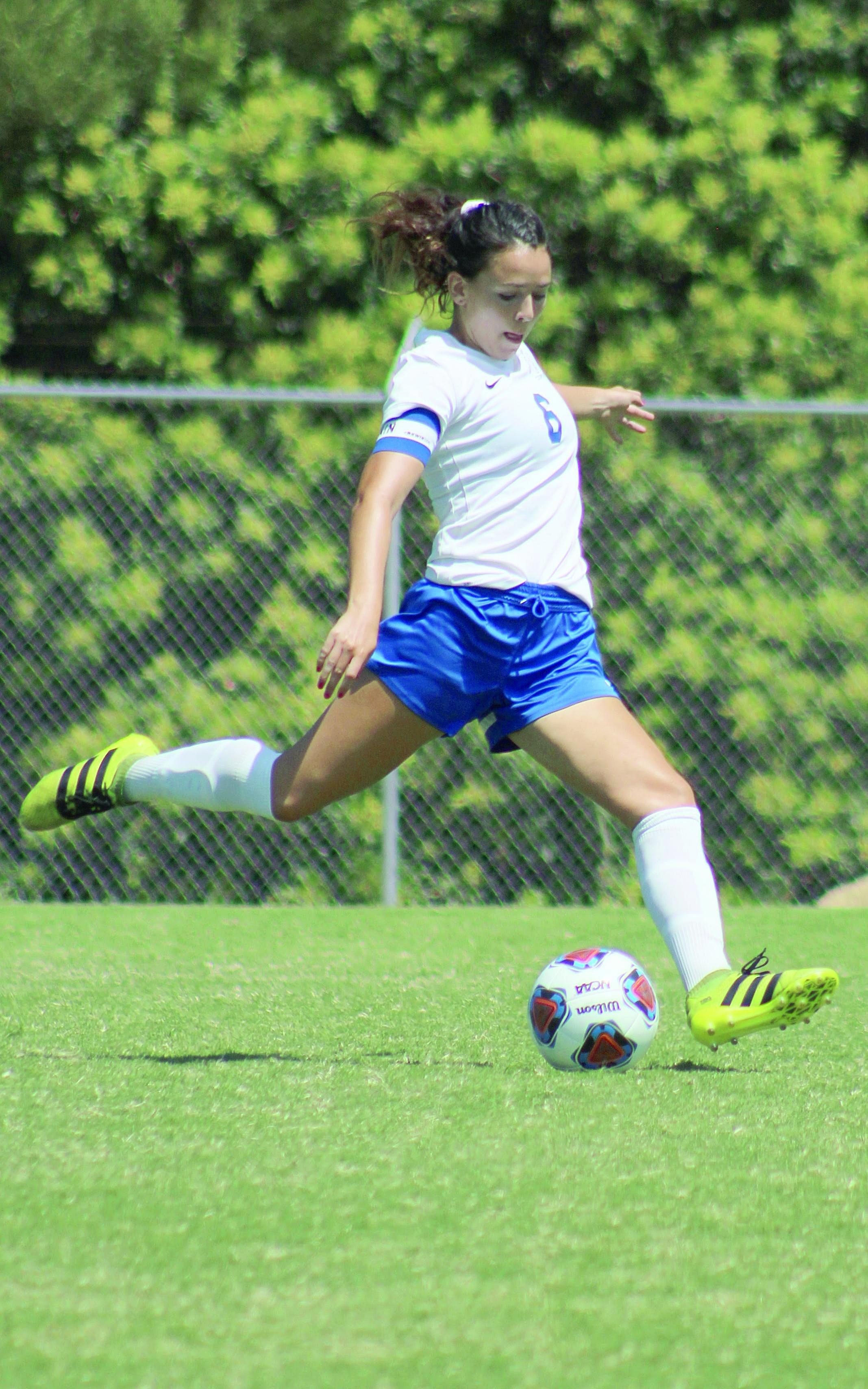 Number six sophomore Antoinette Saldana crosses ball across field at Mira Costa College in Oceanside,Calif. September 7, 2018. (Samantha Morales/Corsair Photo)