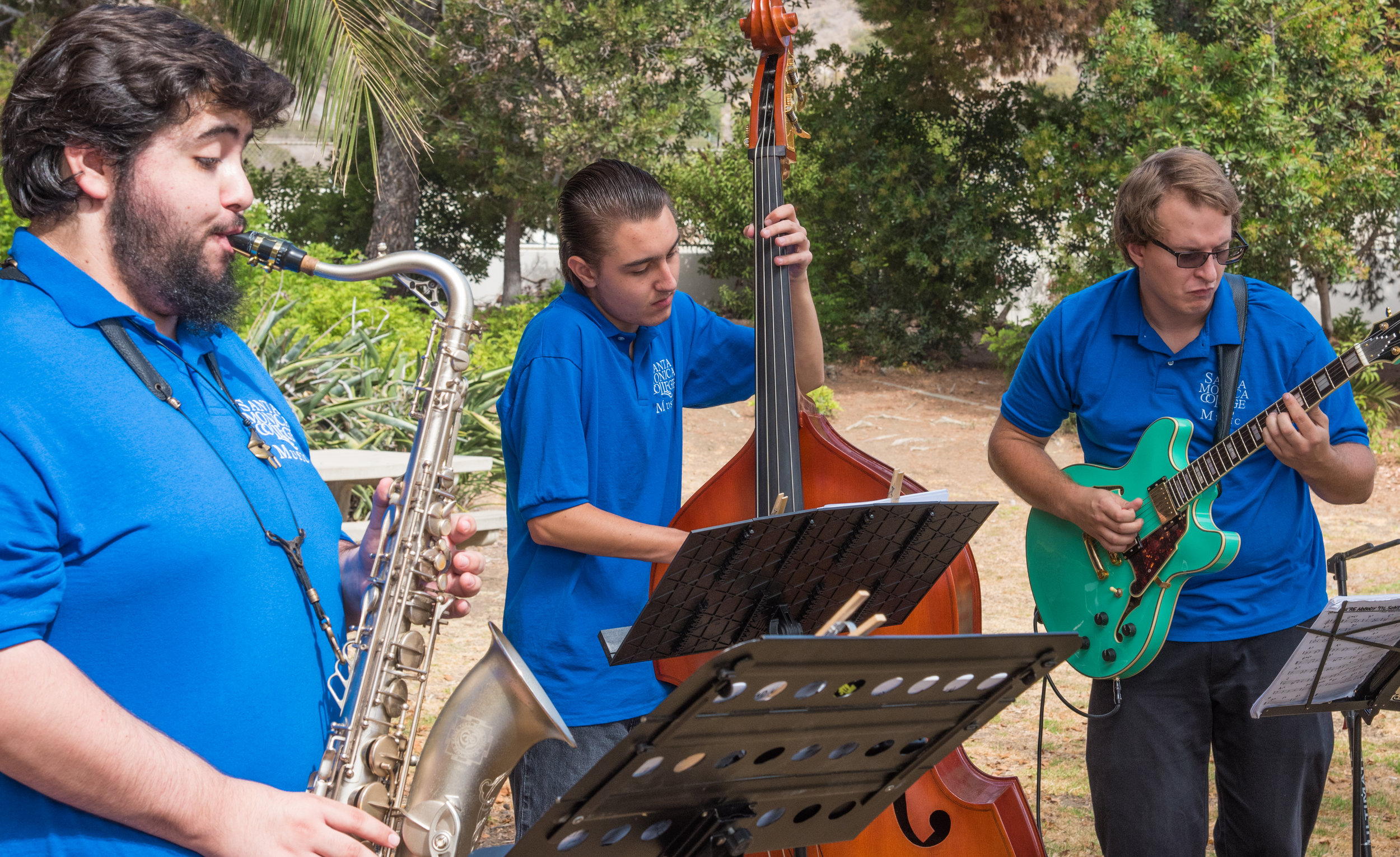 Christian Alva (left), Max Zwarych (center), and Malcom Fisher (right), jazz musicians from Santa Monica College's Applied Music program, perfrom shortly before the official ground breaking ceremony of the Santa Monica College Malibu Campus & Los Angeles County Sheriff's Substation on September 21, 2018 in Malibu, California.