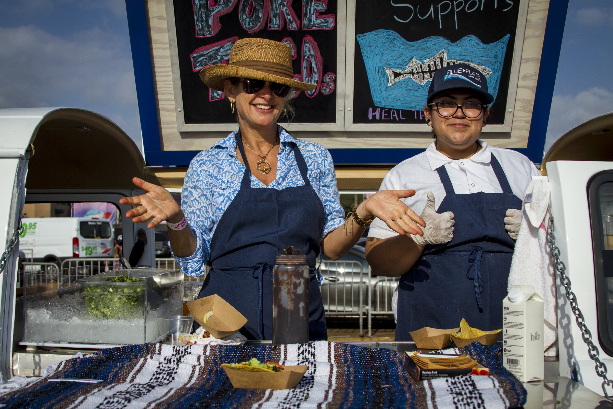 Jennifer Rush (left) and Selenia Melendez (right) hand out ahi tuna taco from their mobile van. At the Off the Hook Seafood Festival. Oct. 6, 2018. By Yasser Marte.