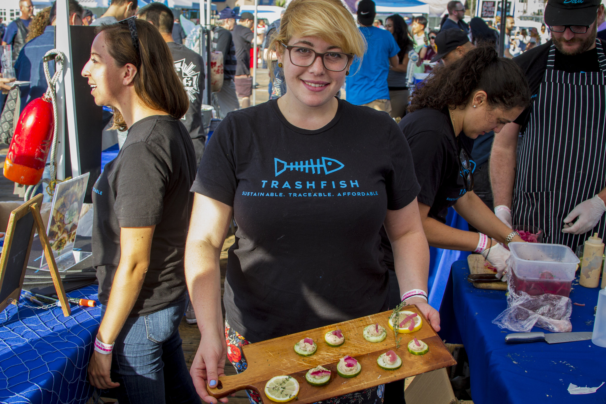 Ren Ostry shows off her petri cumcumber opah fish dish. At Off the Hook Seafood Festival. Oct. 6, 2018. By Yasser Marte.